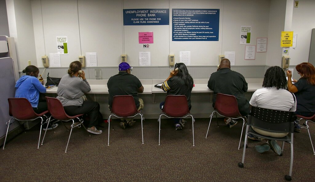 In this Sept. 20, 2013, file photo, visitors use the Unemployment Insurance phone bank at the California Employment Development Department, EDD office in Sacramento, Calif. (Rich Pedroncelli / Associated Press)