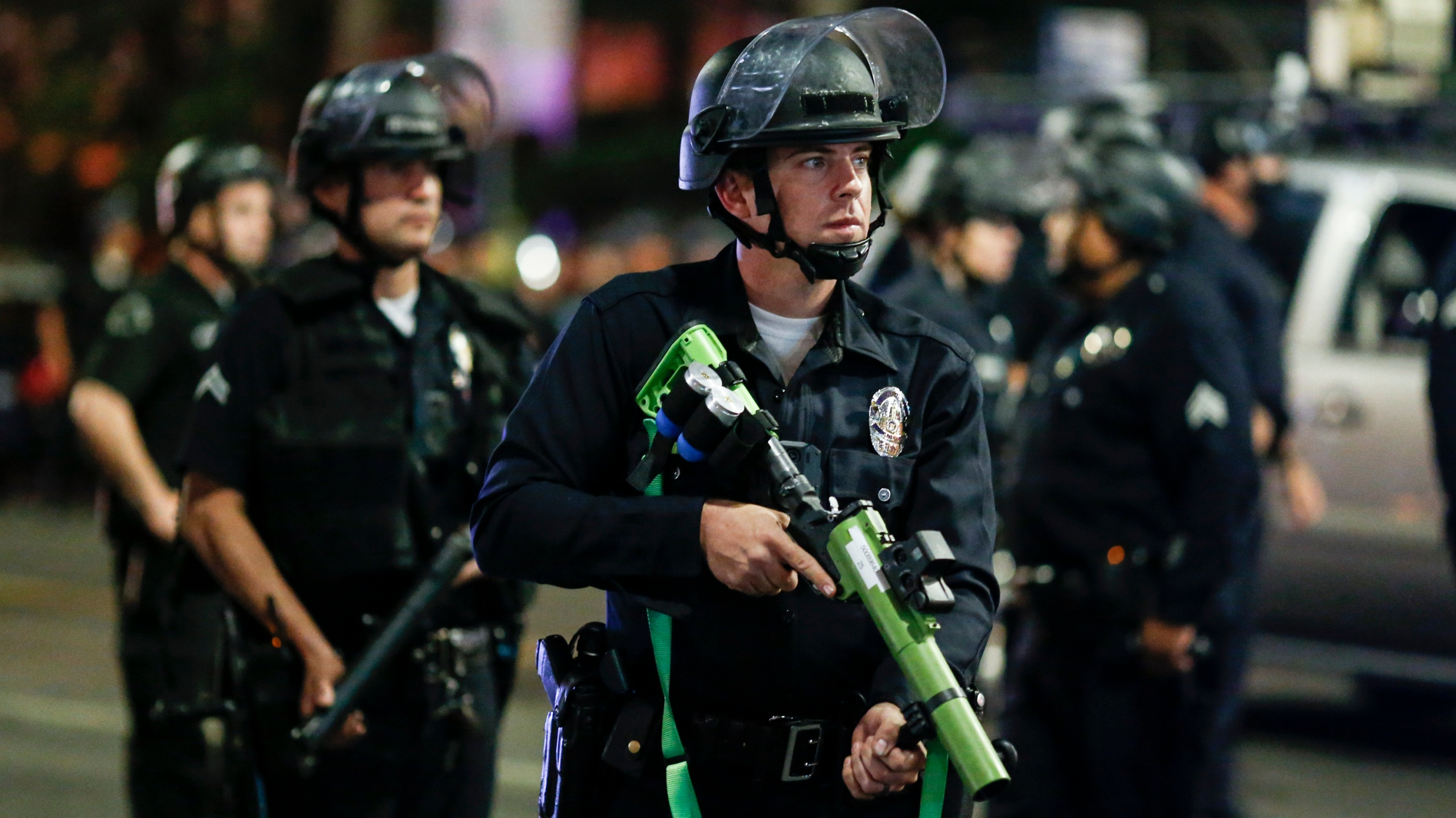 Police officers stand guard as they clear the streets during a protest in Los Angeles following the presidential election on Nov. 4, 2020. (Ringo H.W. Chiu / Associated Press)