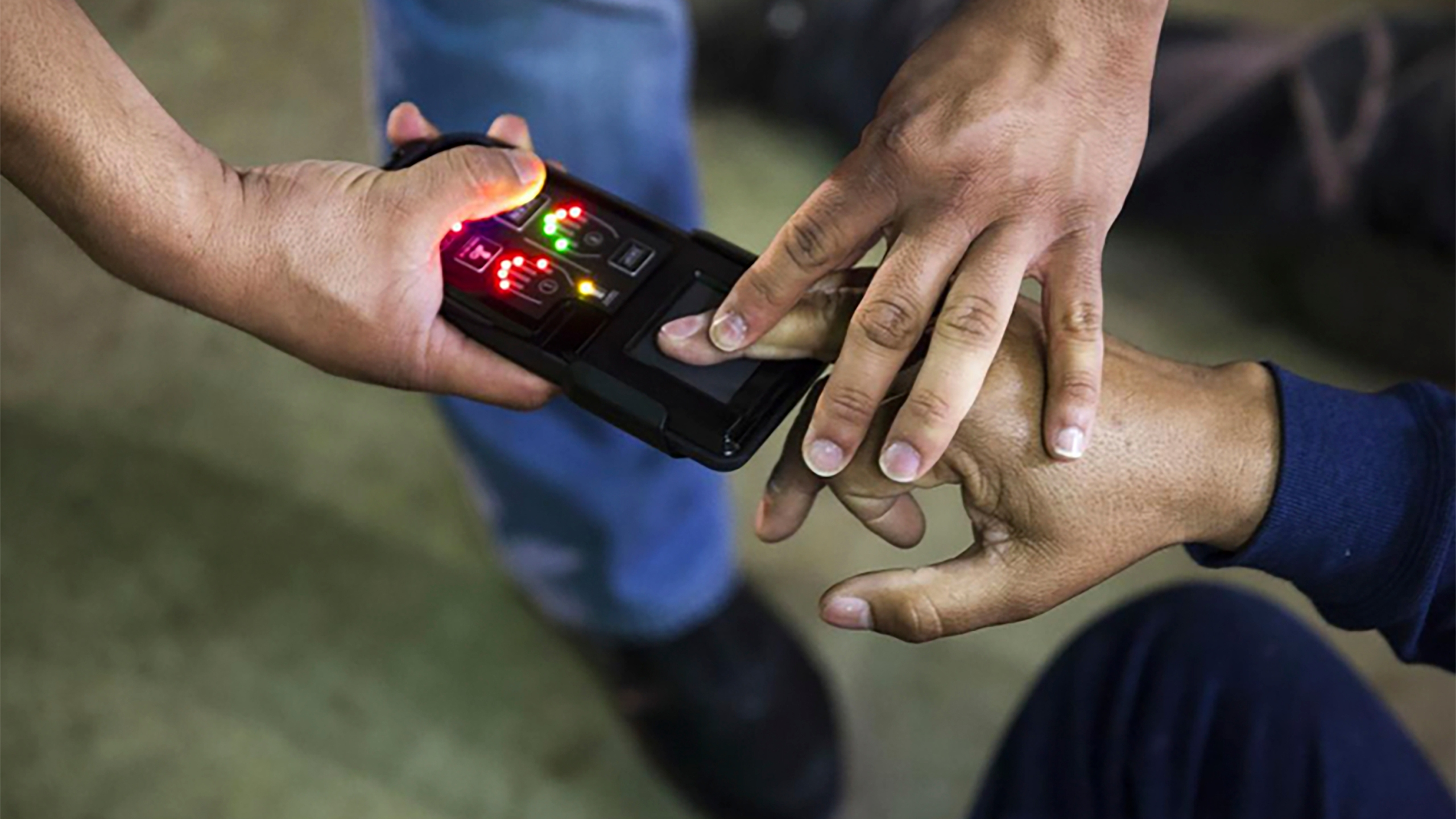 This undated photo obtained from Immigration and Customs Enforcement (ICE) shows a NeoScan 45 fingerprint scanner. The device, paired with an app known as EDDIE, is used by ICE to run remote ID checks.(Immigration and Customs Enforcement via AP)