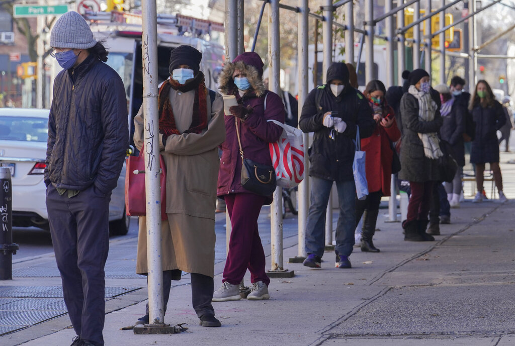 People wait on a line stretching around a block for a clinic offering COVID-19 testing on Nov. 18, 2020, in the Park Slope area of the Brooklyn borough of New York. (AP Photo/Bebeto Matthews)