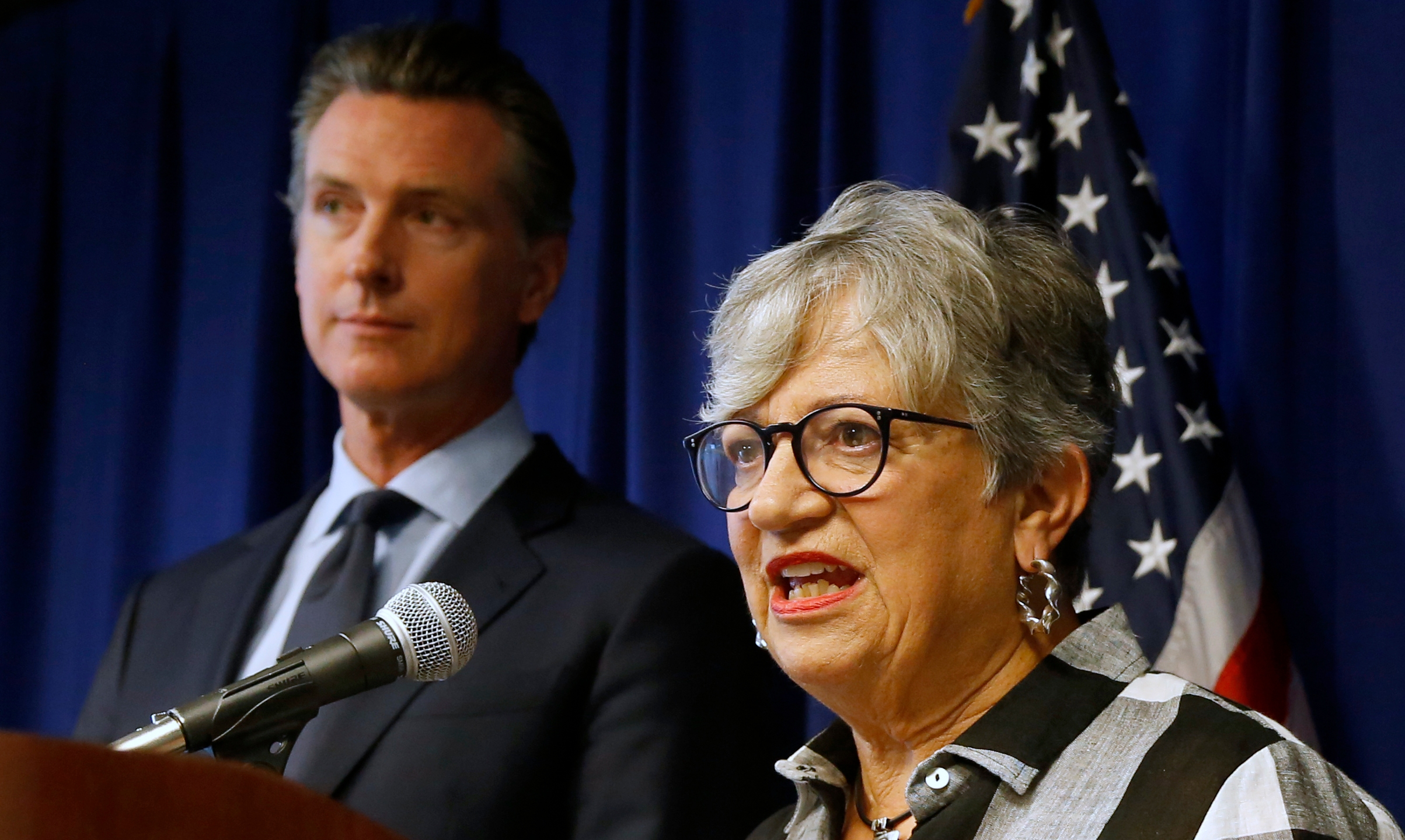 In this Sept. 18, 2019, file photo, California Air Resources Board Chair Mary Nichols, with California Gov. Gavin Newsom at left, discusses the Trump administration's pledge to revoke California's authority to set vehicle emissions standards that are different than the federal standards, during a news conference in Sacramento. (Rich Pedroncelli / Associated Press)