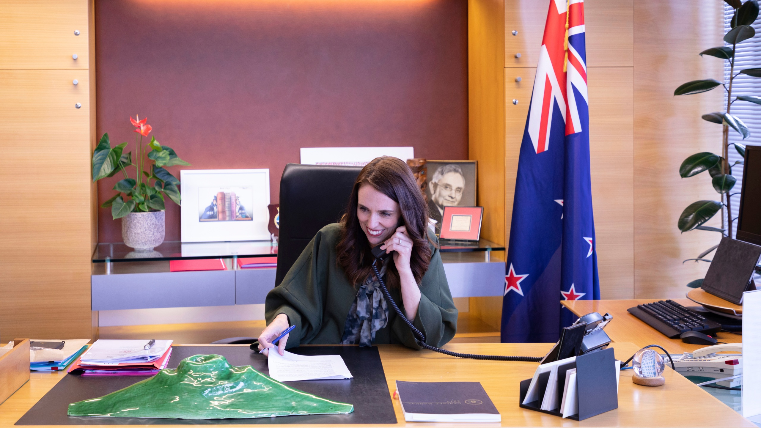 In this photo provided by New Zealand Prime Minister's Office, Prime Minister Jacinda Ardern talks with U.S. President-elect Joe Biden on phone at her office in Wellington, New Zealand, Monday, Nov. 23, 2020. (New Zealand Prime Minister's Office via AP)