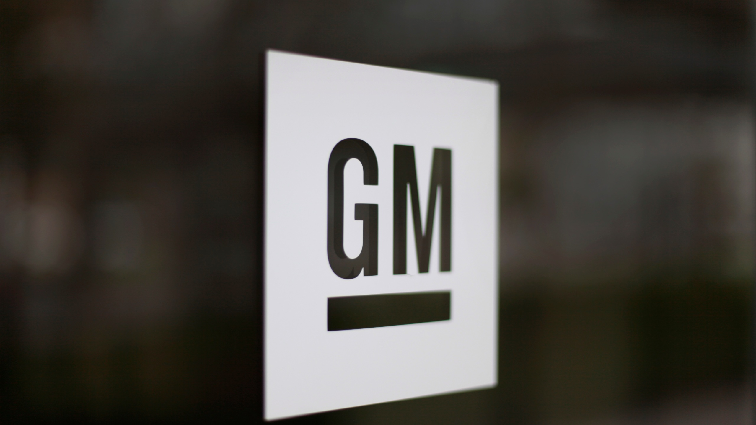 This May 16, 2014, file photo, shows the General Motors logo at the company's world headquarters in Detroit. (AP Photo/Paul Sancya, File)