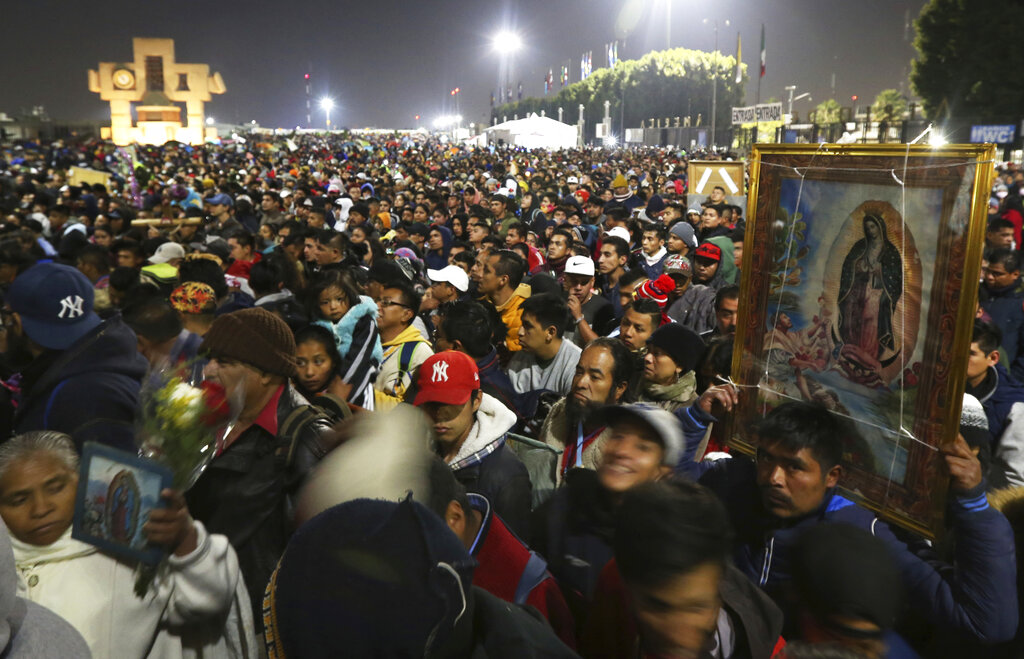 In this Dec. 12, 2019 file photo, pilgrims arrive at the plaza outside the Basilica of Our Lady of Guadalupe in Mexico City. (AP Photo/Marco Ugarte, File)