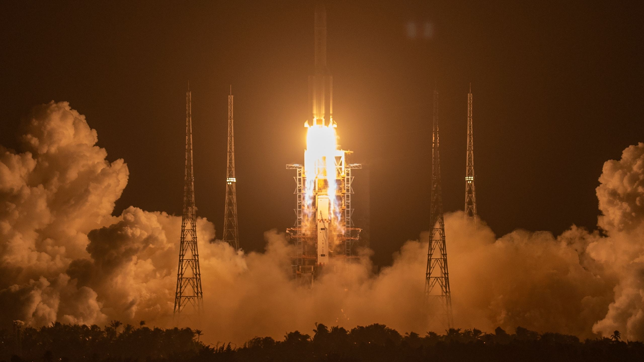 A Long March-5 rocket carrying the Chang'e 5 lunar mission lifts off at the Wenchang Space Launch Center in Wenchang in southern China's Hainan Province on Nov. 24, 2020. (AP Photo/Mark Schiefelbein)