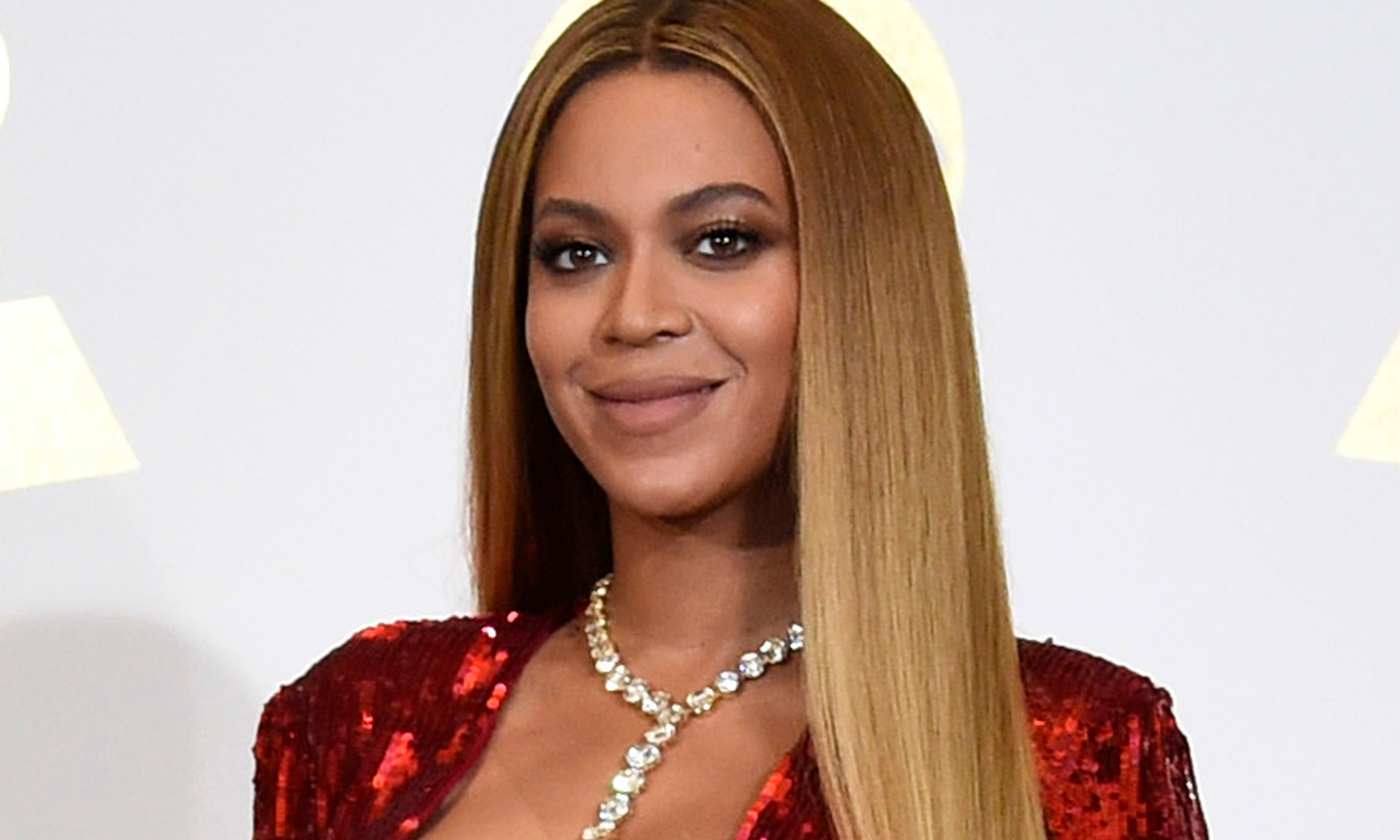 In this Feb. 12, 2017 file photo, Beyonce poses in the press room at the 59th annual Grammy Awards in Los Angeles. The pop star scored multiple Grammy nominations Tuesday, making her the leading contender with nine nominations. (Photo by Chris Pizzello/Invision/AP, File)