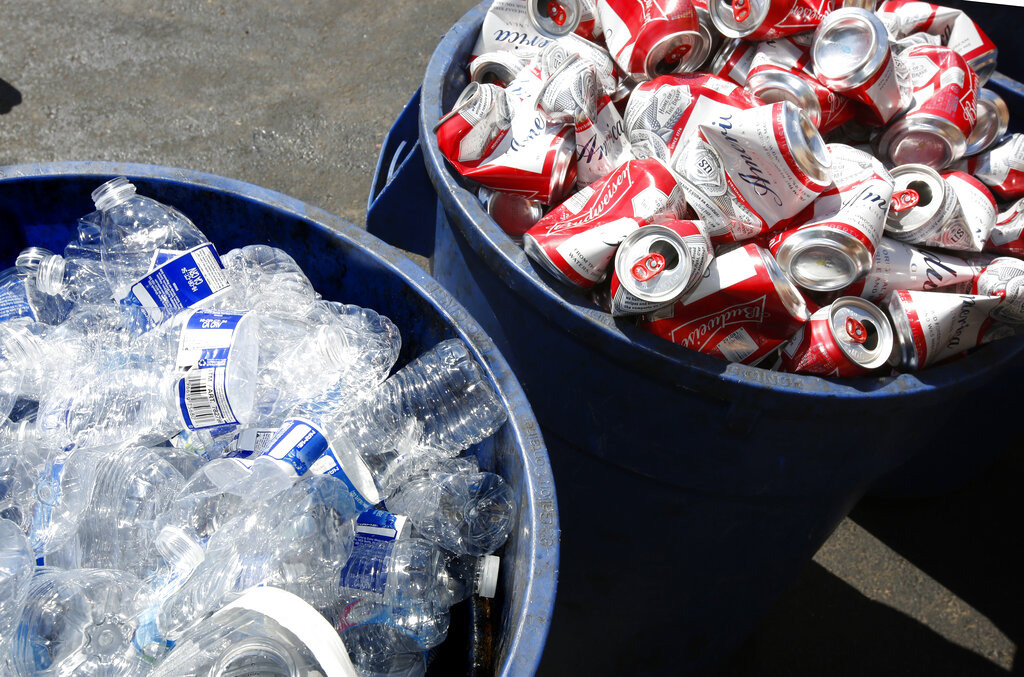 In this July 5, 2016, file photo, cans and plastic bottles brought in for recycling fill containers at a recycling center in Sacramento, Calif. (AP Photo/Rich Pedroncelli, File)