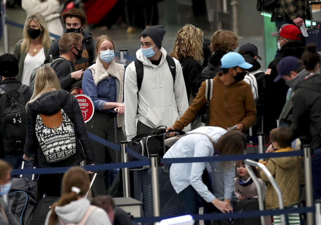 Millions of Americans risk traveling over Thanksgiving holiday amid skyrocketing coronavirus case numbers