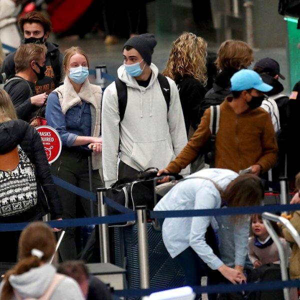 Holiday travelers crowd the ticketing area of terminal one Nov. 25, 2020 at MSP in Minneapolis. (David Joles/Star Tribune via AP)