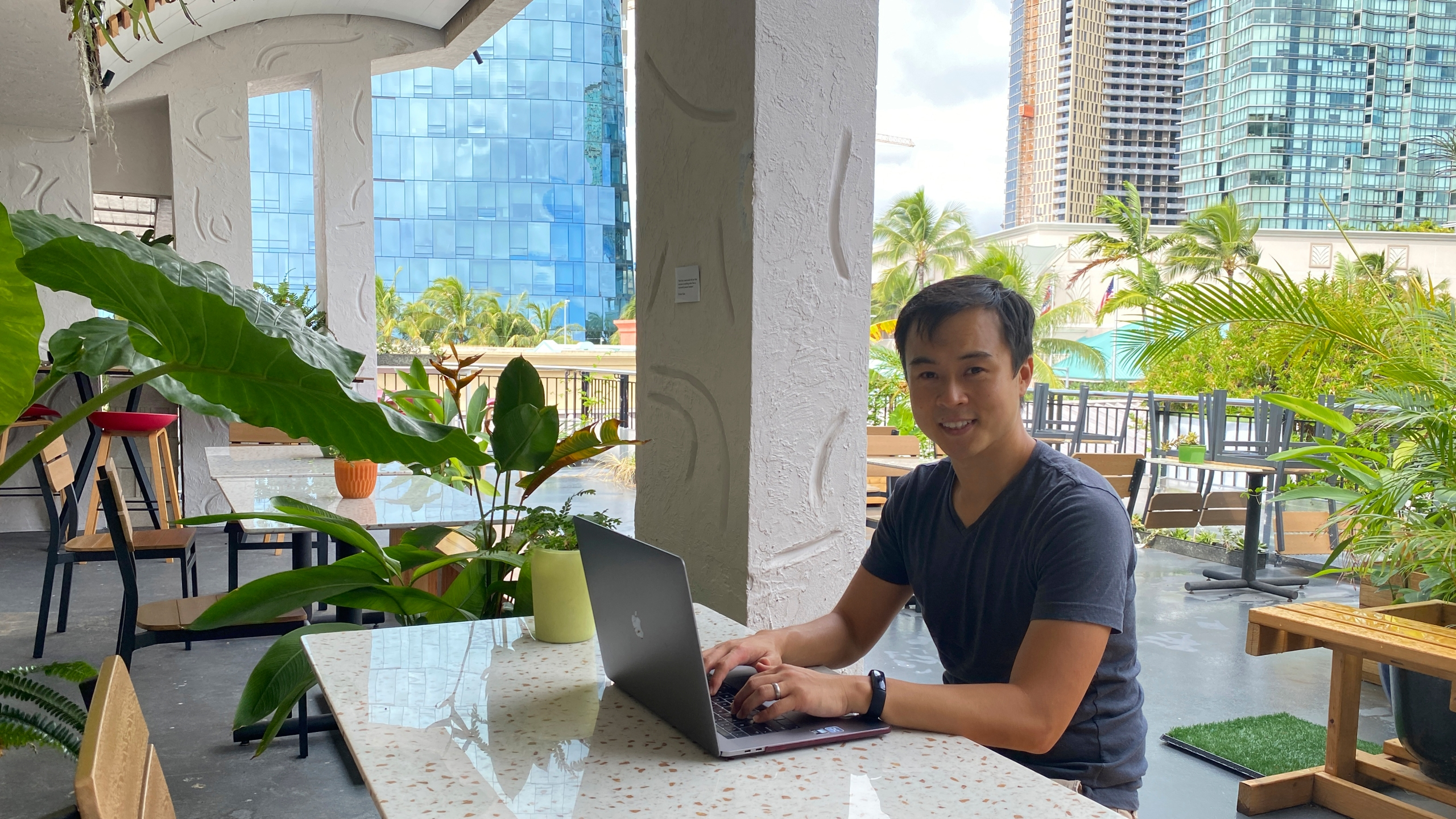 In this photo provided by Ashley McCue, Richard Matsui works from a coworking space on Nov. 18, 2020, in Honolulu. (Ashley McCue via AP)