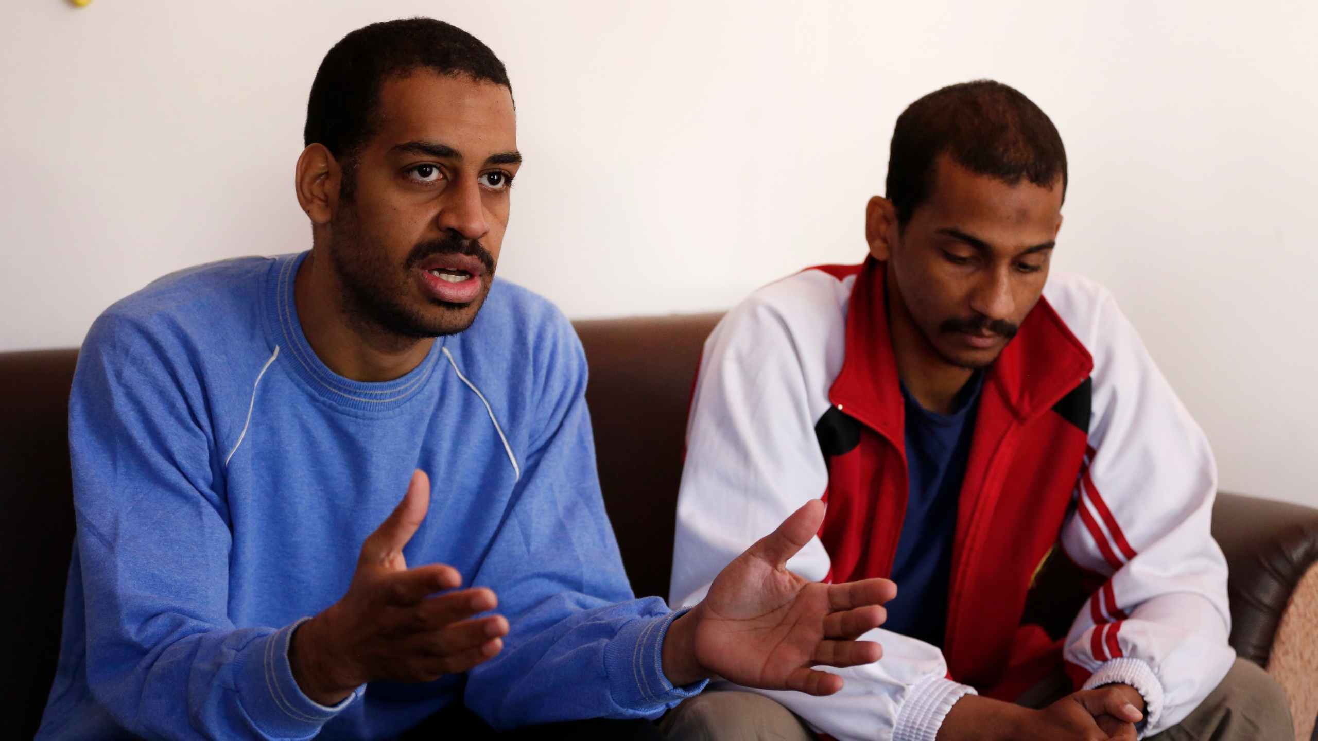 "In this March 30, 2019, file photo, Alexanda Amon Kotey, left, and El Shafee Elsheikh, who were allegedly among four British jihadis who made up a brutal Islamic State cell dubbed ""The Beatles,"" speak during an interview with The Associated Press at a security center in Kobani, Syria. (Hussein Malla/AP Photo)"