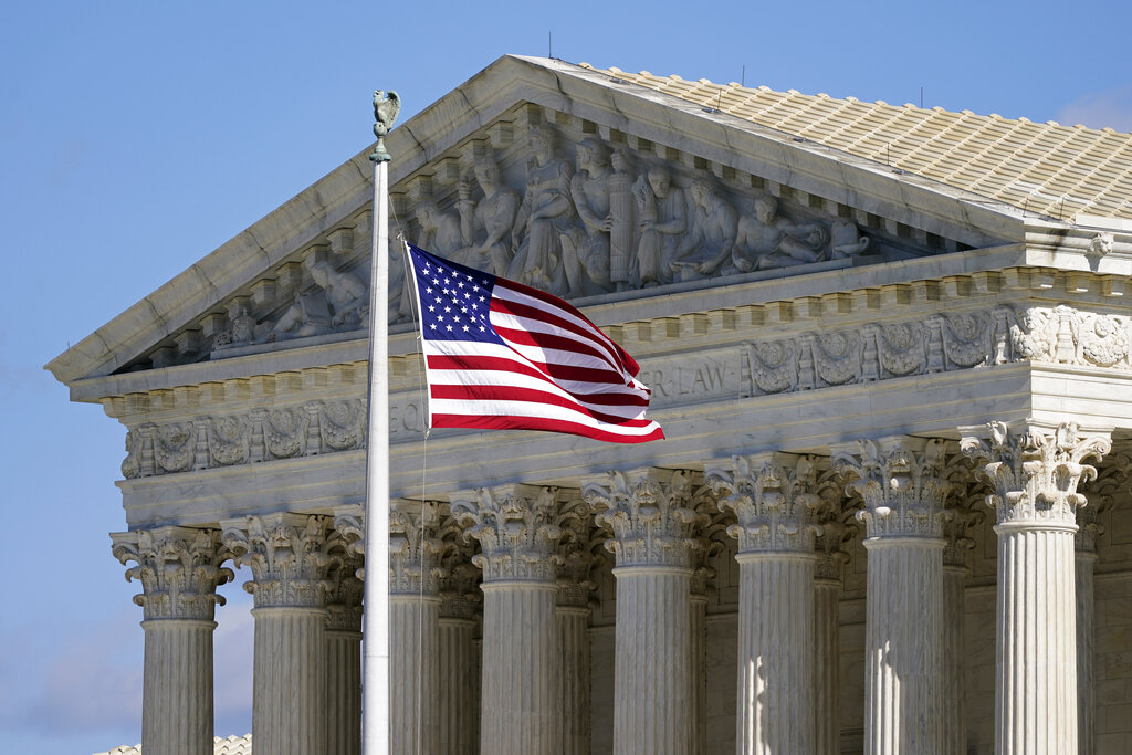 In this Nov. 2, 2020, file photo an American flag waves in front of the Supreme Court building on Capitol Hill in Washington. (AP Photo/Patrick Semansky, File)