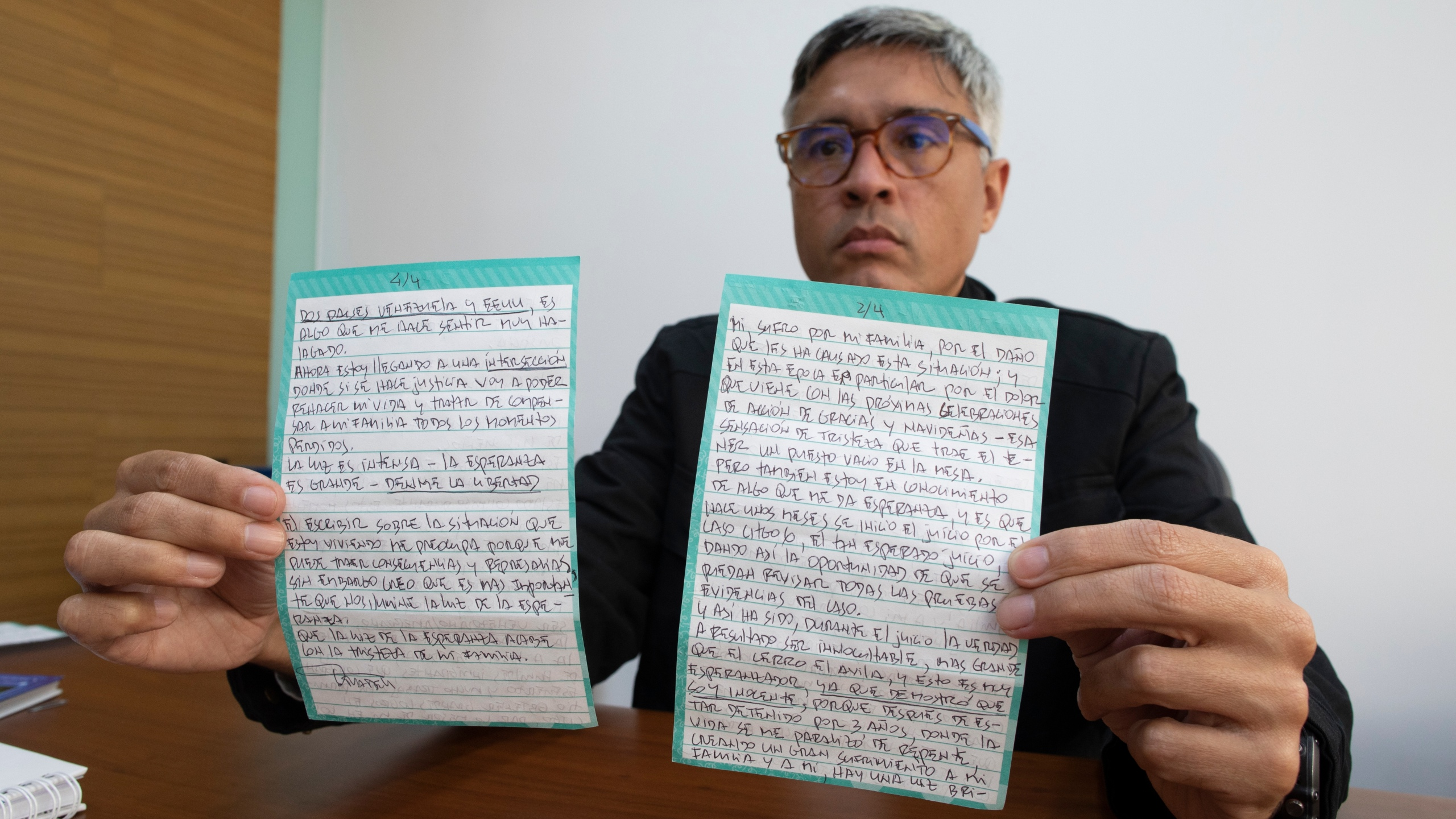 Jesus Loreto, an attorney representing Tomeu Vadell, one of six U.S. oil executives jailed for three years in Venezuela, shows a letter written by Vadell, in Caracas, Venezuela, Wednesday, Nov. 25, 2020. (Ariana Cubillos/AP Photo)
