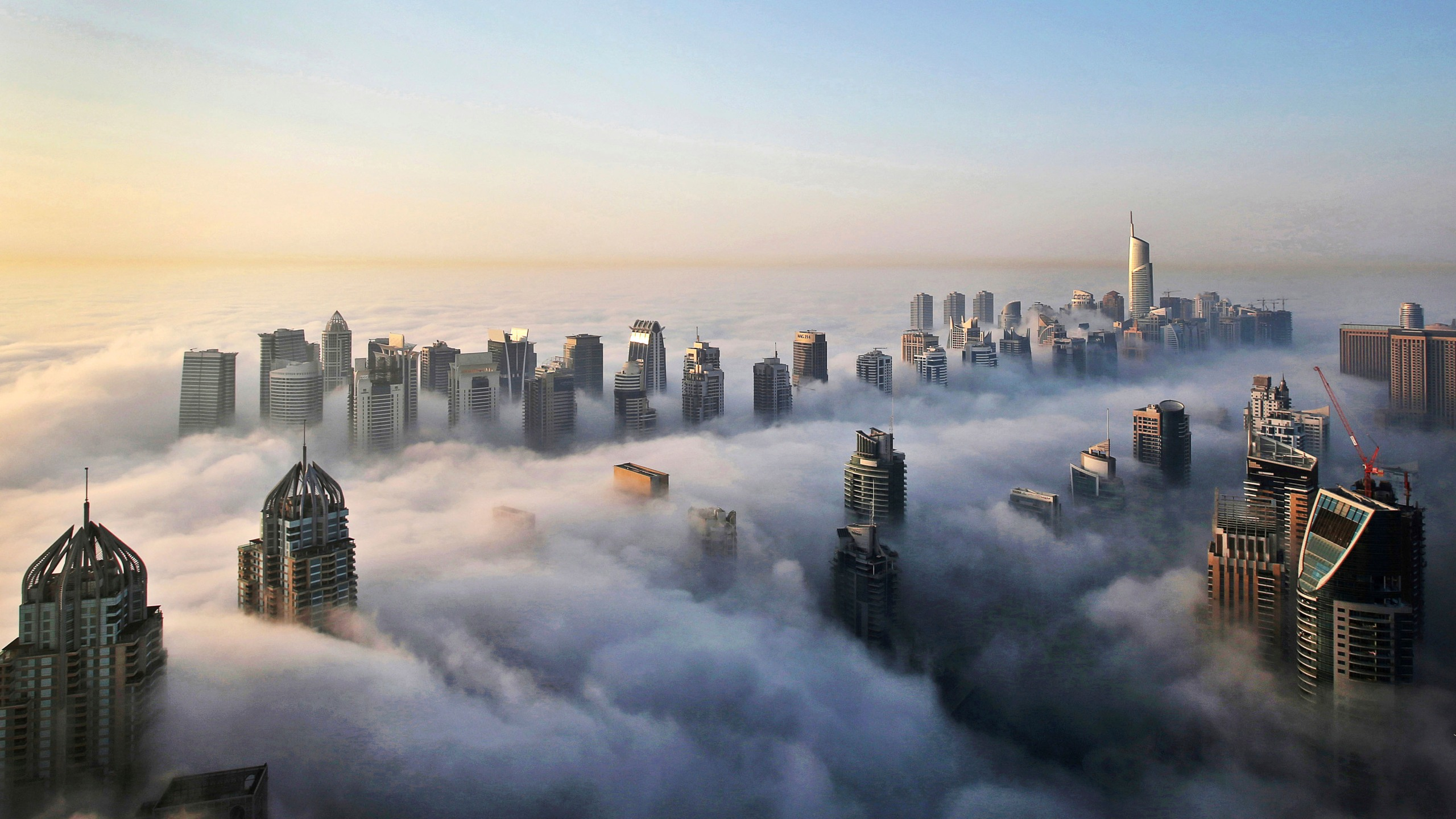 In this Monday, Oct. 5, 2015 file photo, a thick blanket of early morning fog partially shrouds the skyscrapers of the Marina and Jumeirah Lake Towers districts of Dubai, United Arab Emirates. (Kamran Jebreili/AP Photo)