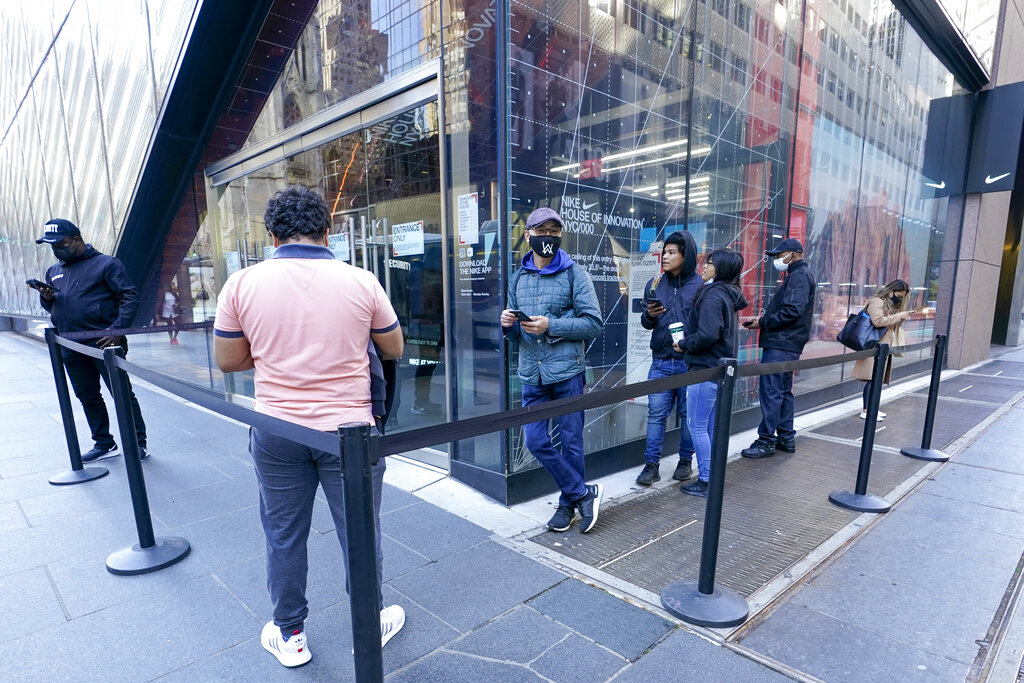 Black Friday shoppers wait in line to enter the Nike store along Fifth Avenue, Friday, Nov. 27, 2020, in New York. (AP Photo/Mary Altaffer)