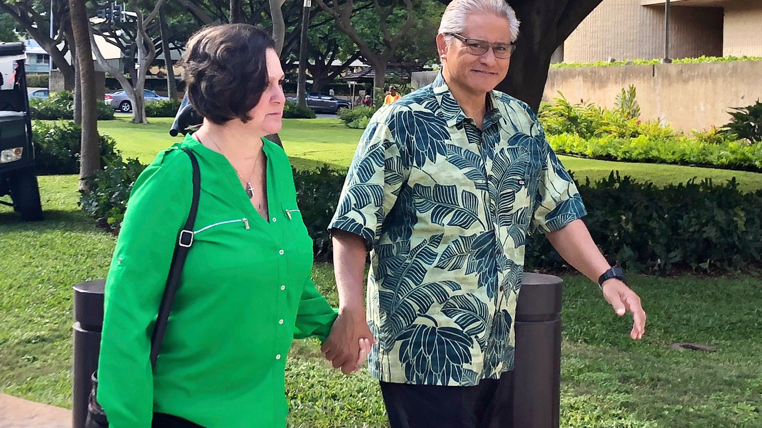 In this March 12, 2019, file photo, retired Honolulu police chief Louis Kealoha and his wife, former deputy city prosecutor Katherine Kealoha, hold hands while walking to U.S. district court in Honolulu. (Jennifer Sinco Kelleher/AP Photo)