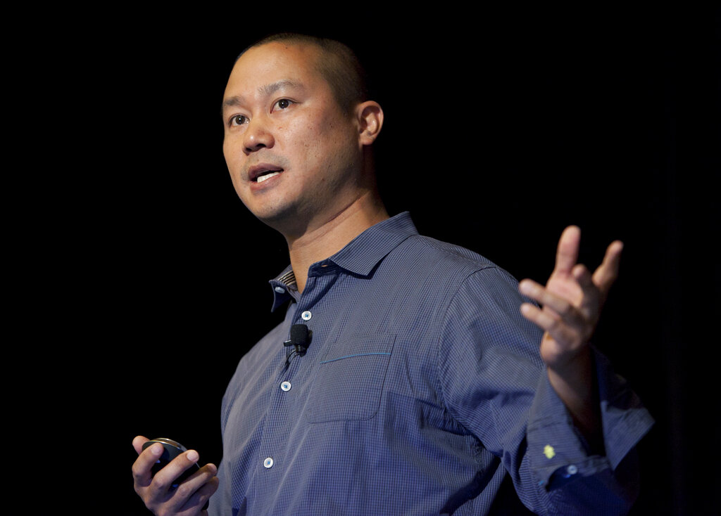 In this Sept. 30, 2013, file photo, Tony Hsieh speaks during a Grand Rapids Economic Club luncheon in Grand Rapids, Mich. (Cory Morse/The Grand Rapids Press via AP, File)