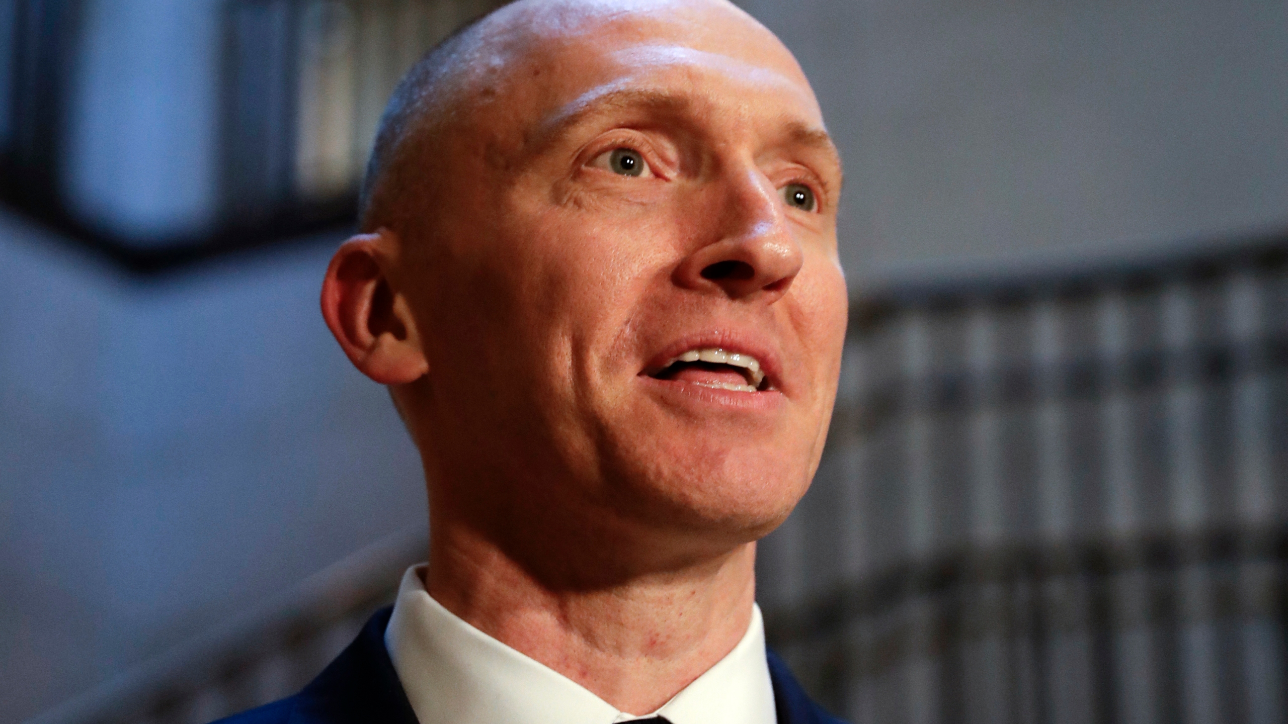 "In this Nov. 2, 2017, photo, Carter Page, a foreign policy adviser to Donald Trump's 2016 presidential campaign, speaks with reporters following a day of questions from the House Intelligence Committee, on Capitol Hill in Washington. Page, who was the target of a secret surveillance warrant during the FBI's Russia investigation says in a federal lawsuit filed Friday, Nov. 27, 2020, that he was the victim of ""unlawful spying."" The suit from Carter Page alleges a series of omissions and errors made by FBI and Justice Department officials in applications they submitted to the Foreign Intelligence Surveillance Court to eavesdrop on Page on suspicion that he was an agent of Russia. (AP Photo/J. Scott Applewhite)"