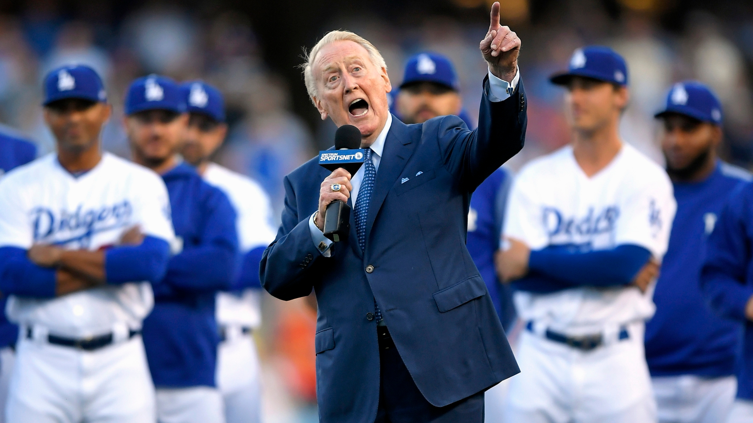 In this May 3, 2017, file photo, Los Angeles Dodgers broadcaster Vin Scully speaks during his induction into the team's Ring of Honor prior to a baseball game between the Dodgers and the San Francisco Giants, in Los Angeles. (AP Photo/Mark J. Terrill, File)