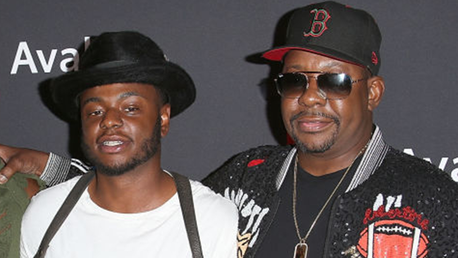 """Bobby Brown Jr., left, and Bobby Brown attend the premiere screening of """"The Bobby Brown Story"""" at the Paramount Theatre in Hollywood on Aug. 29, 2018. (Jesse Grant / Getty Images)"""