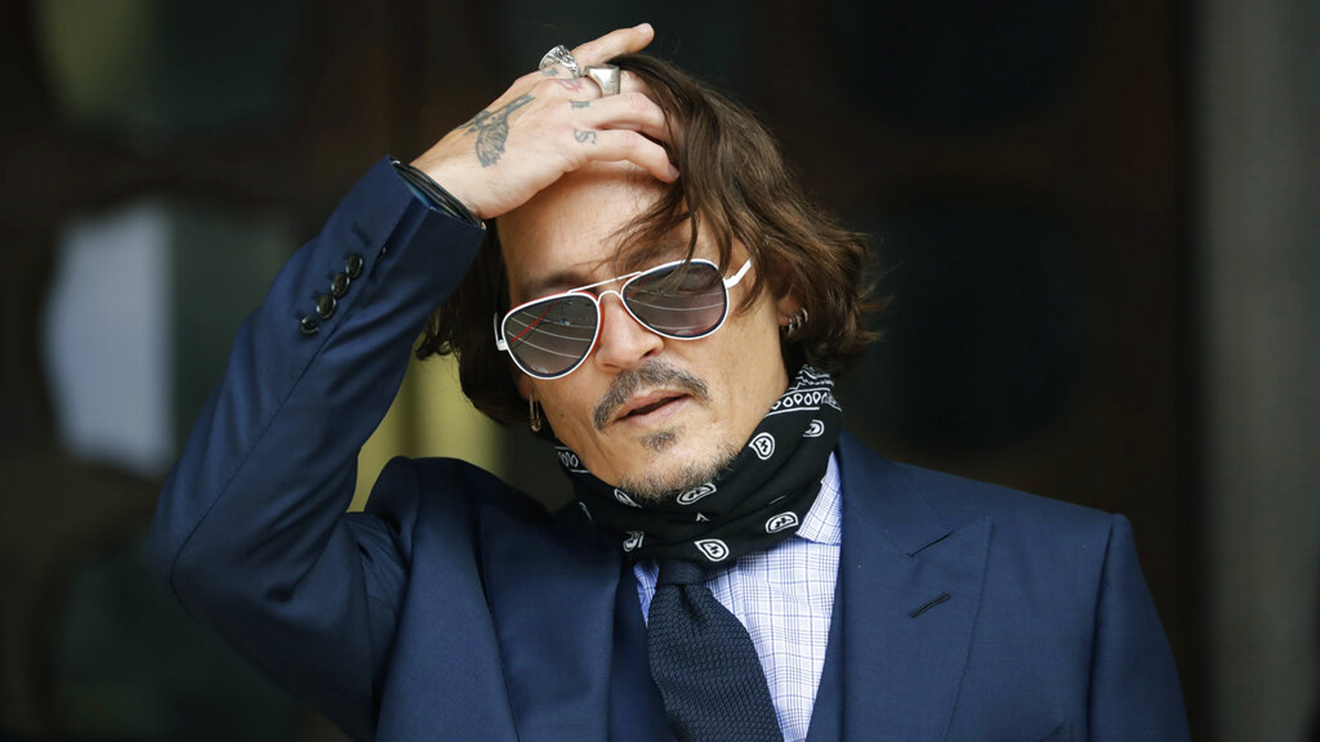 In this Tuesday, July 14, 2020 file photo, American actor Johnny Depp gestures to the media as he arrives at the High Court in London. (AP Photo/Matt Dunham, file)