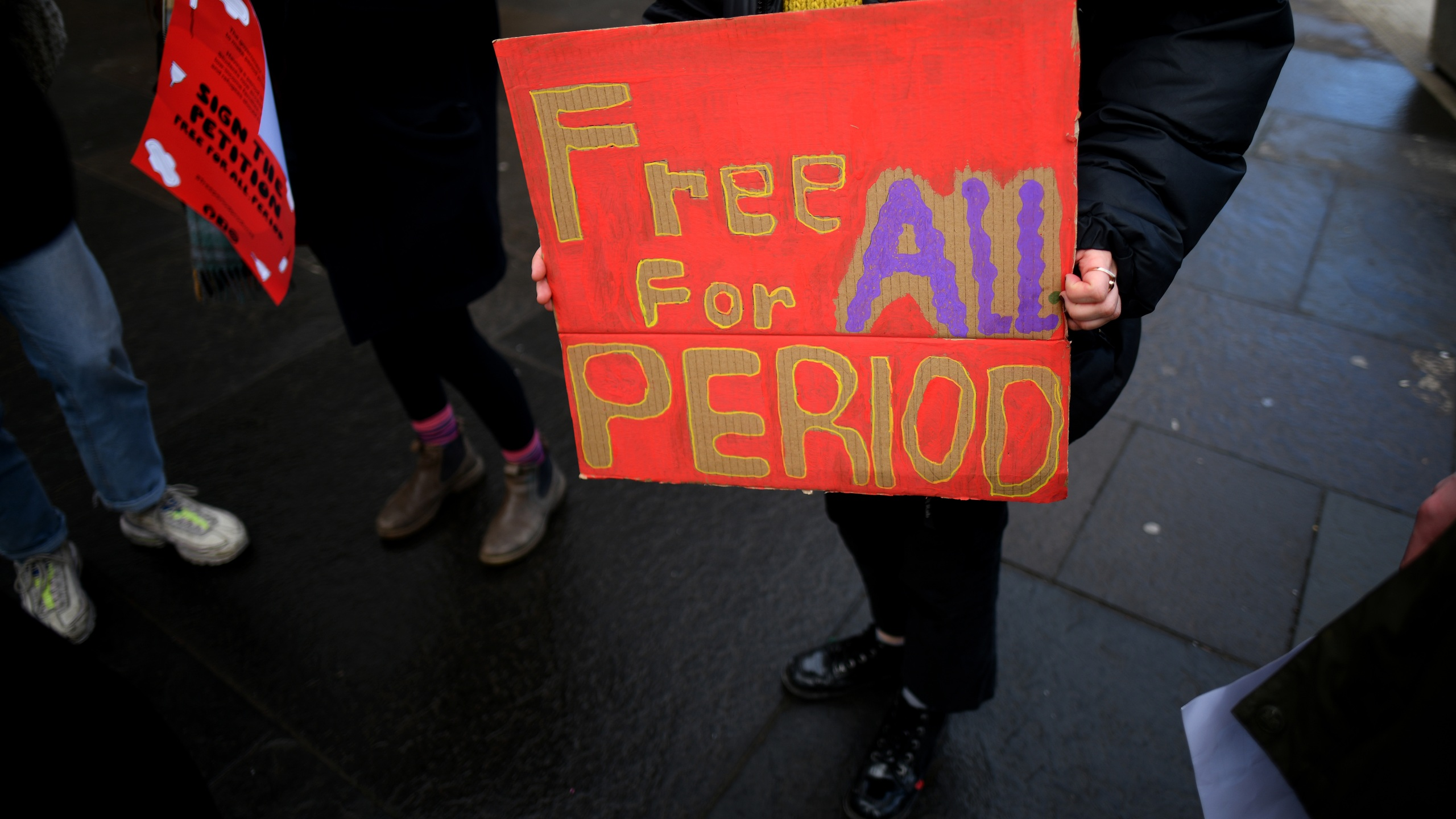 Campaigners and activists rally outside the Scottish Parliament in support of the Scottish Governments Support For Period Products Bill on Feb. 25, 2020 in Edinburgh,Scotland. (Jeff J Mitchell/Getty Images)