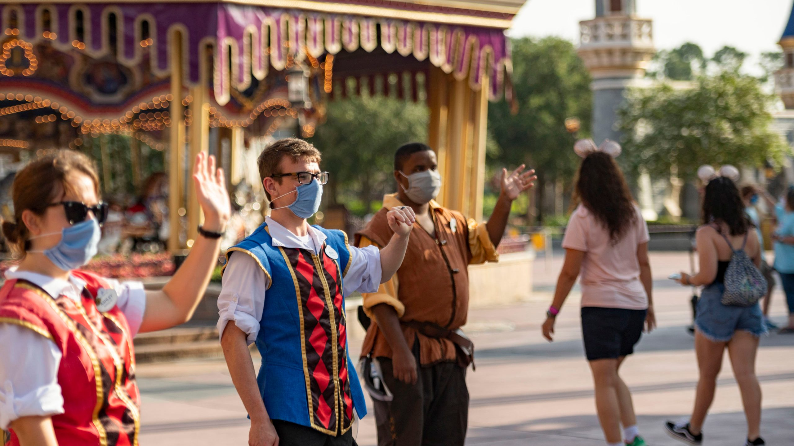 Disney cast members welcome guests to Magic Kingdom Park at Walt Disney World Resort on July 11, 2020 in Lake Buena Vista, Florida. (Matt Stroshane/Walt Disney World Resort via Getty Images)