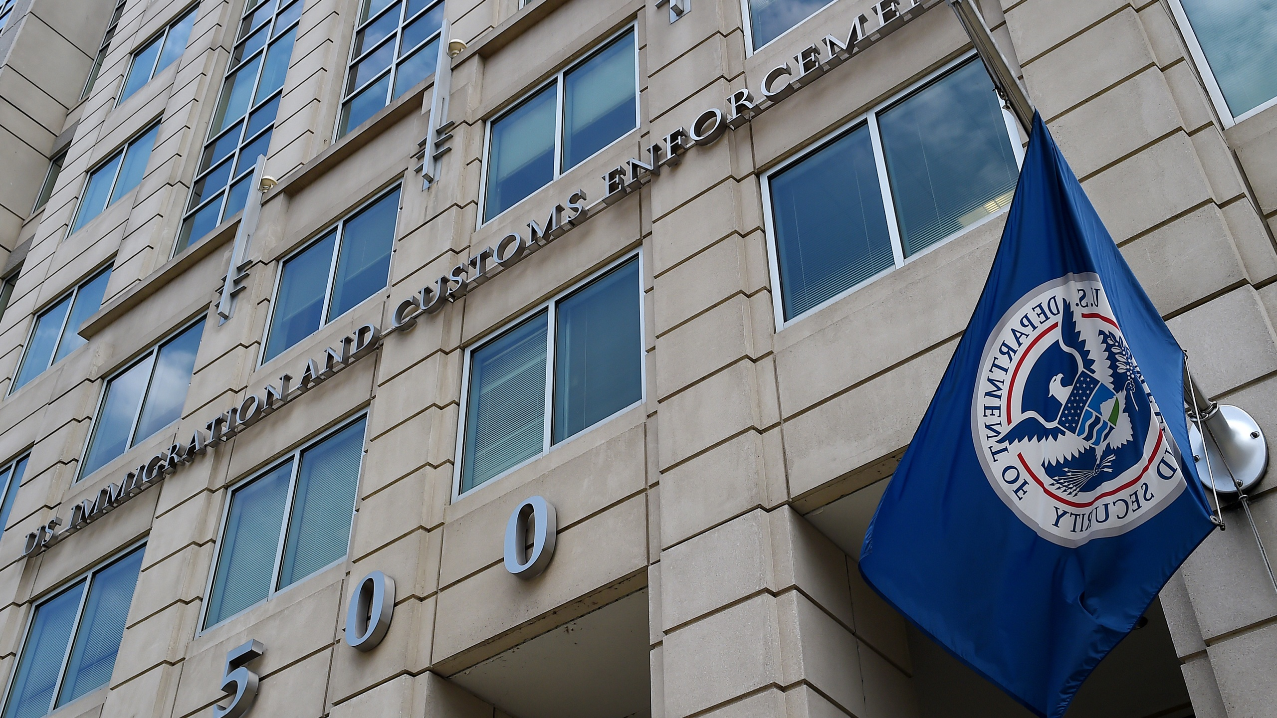 The Department of Homeland Security flag flies outside the Immigration and Customs Enforcement (ICE) headquarters in Washington, DC, on July 17, 2020. (Olivier Douliery/AFP via Getty Images)