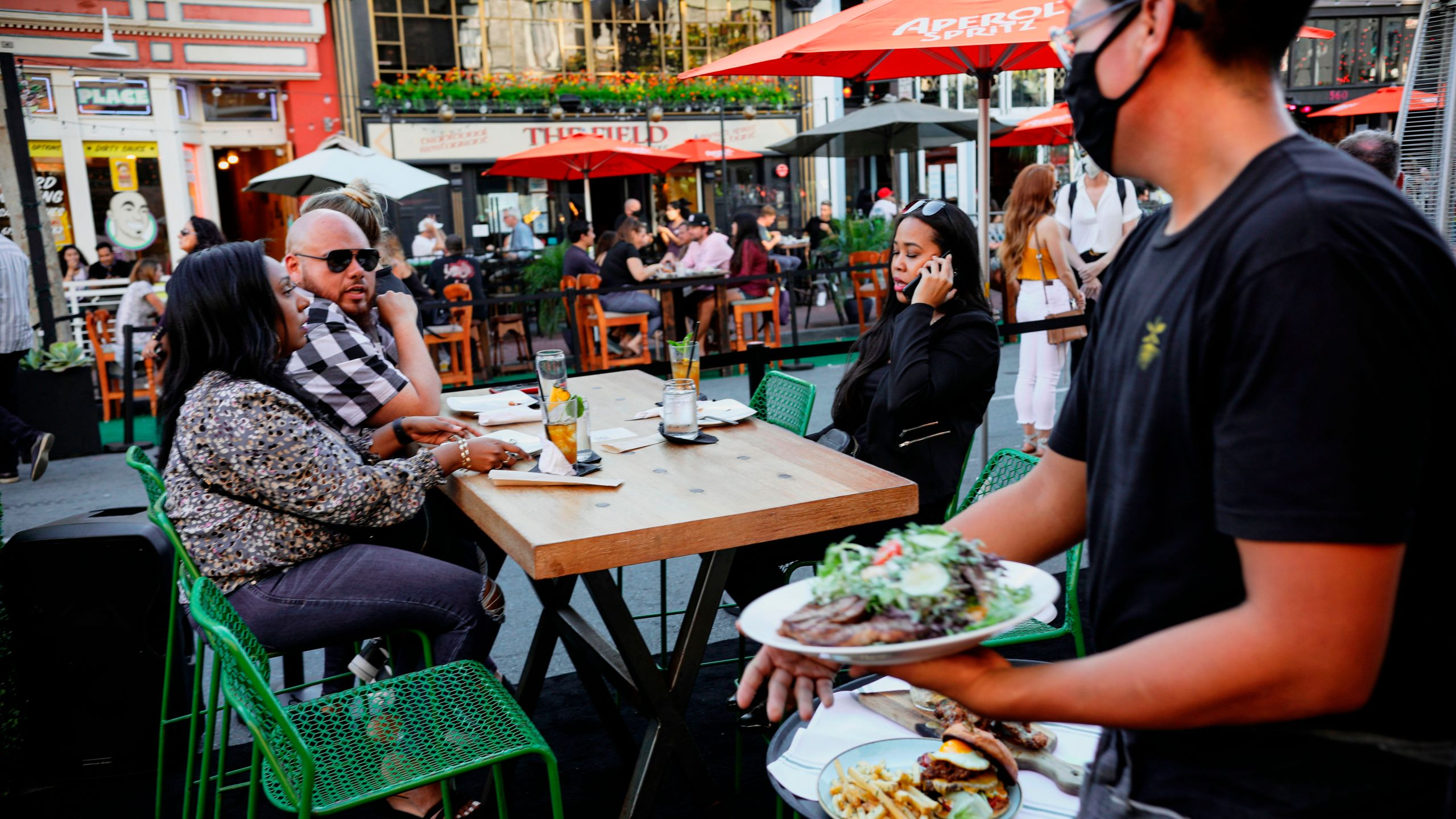 Patrons dine at an outdoor restaurant along 5th Avenue in The Gaslamp Quarter in downtown San Diego, California on, July 17, 2020. (Sandy Huffaker/AFP via Getty Images)