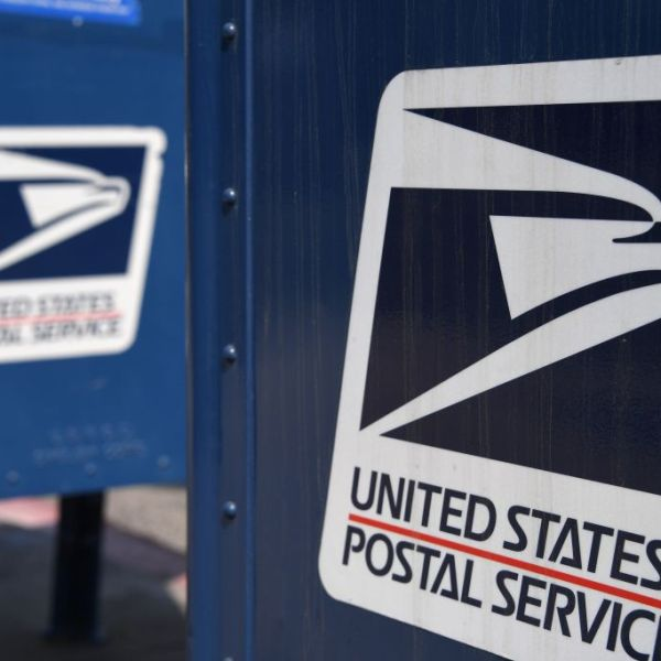 The United States Postal Service logo is seen on a mailbox outside a post office in Los Angeles on Aug. 17, 2020. (Robyn Beck / AFP / Getty Images)
