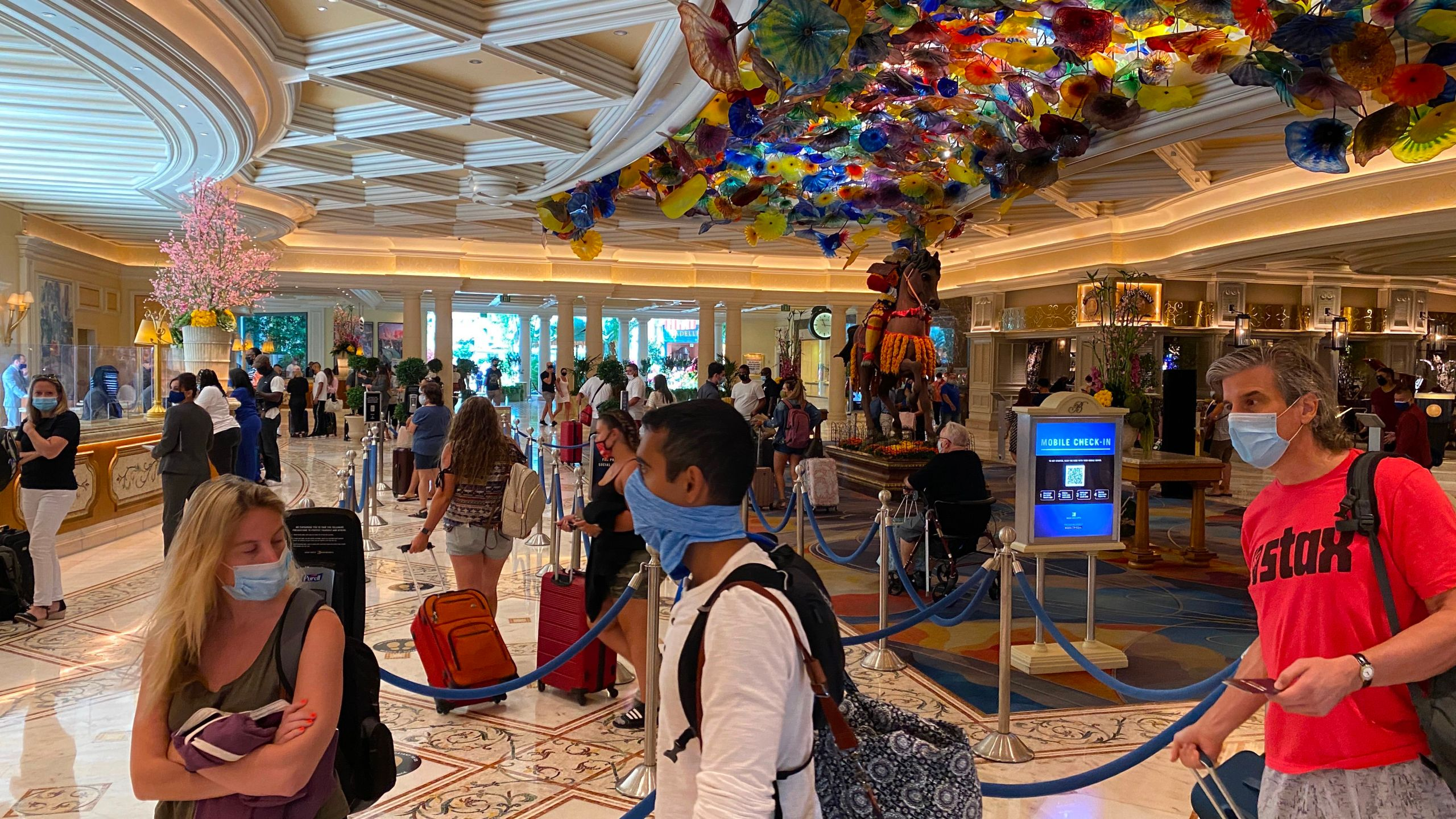 Tourists are wearing a mandatory mask as they wait to check-in at the Bellagio hotel and casino in Las Vegas, Nevada, on Aug. 28, 2020 . (DANIEL SLIM/AFP via Getty Images)
