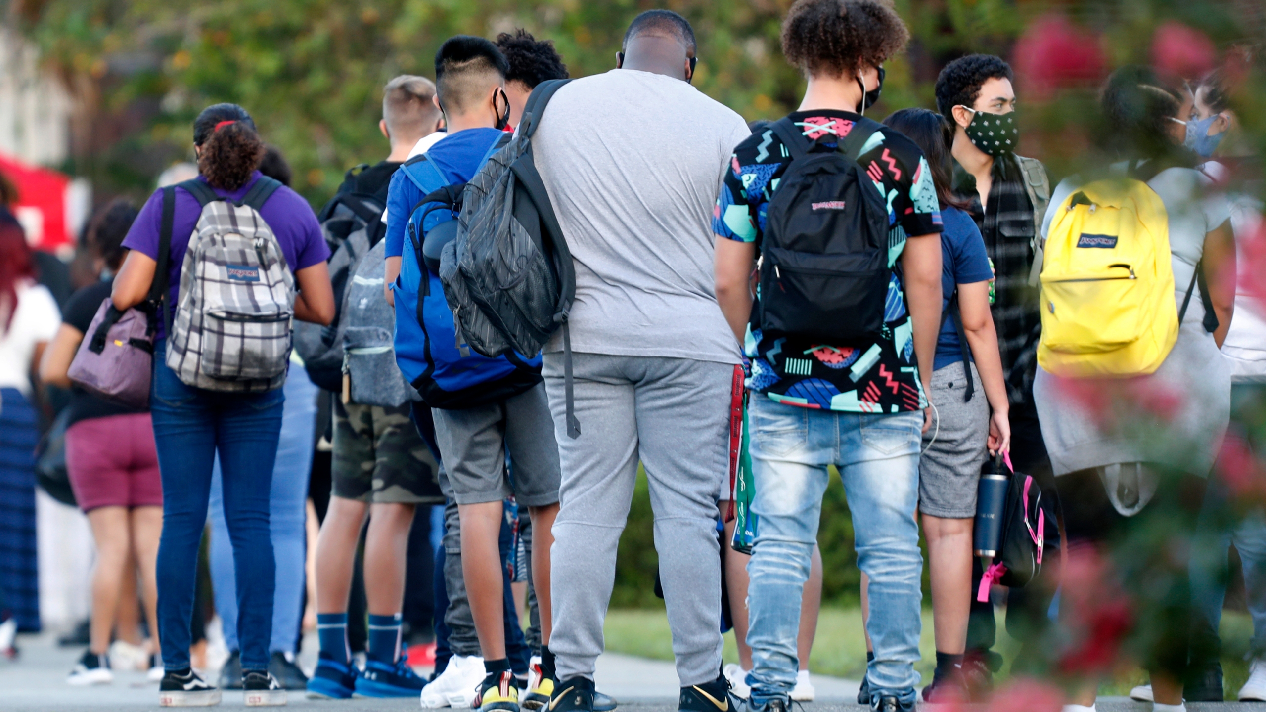 Students at Hillsborough High School in Tampa wait in line to have their temperature checked before entering the building on Aug. 31, 2020. (Octavio Jones / Getty Images)