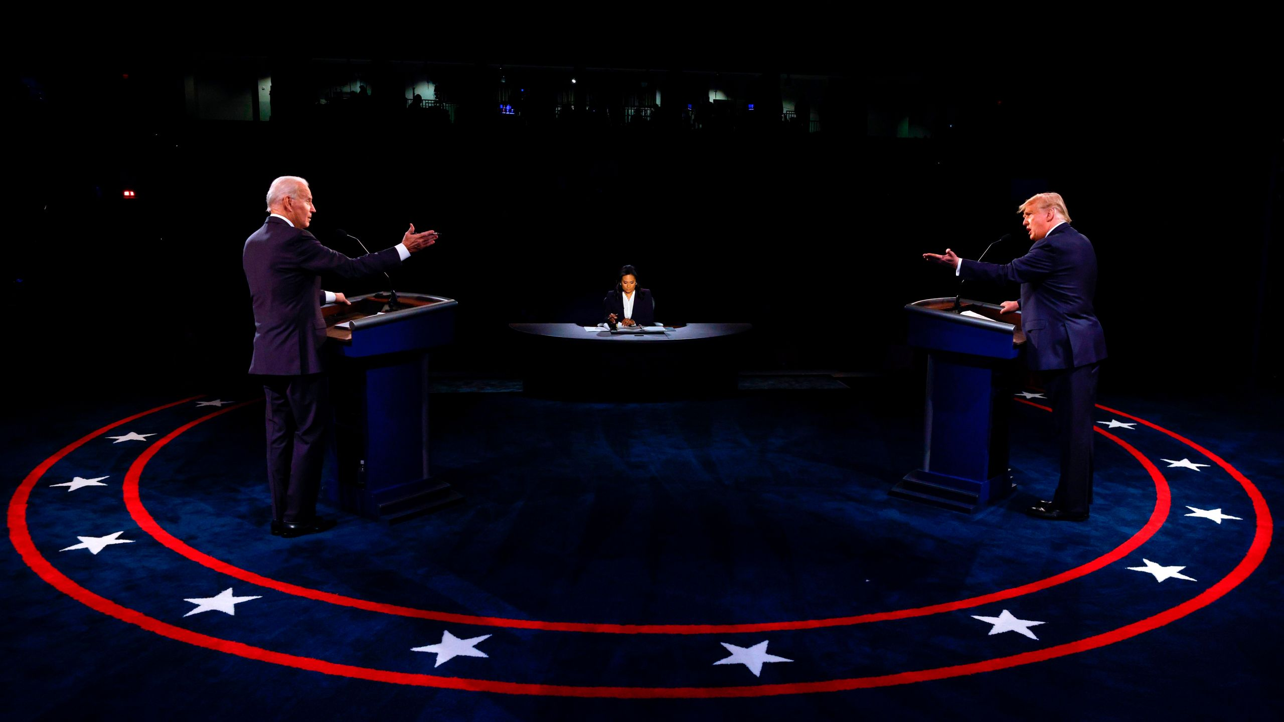 President Donald Trump, Democratic Presidential candidate Joe Biden and moderator, NBC News anchor, Kristen Welker participate in the final presidential debate at Belmont University in Nashville, Tennessee, on Oct. 22, 2020. (JIM BOURG/POOL/AFP via Getty Images)