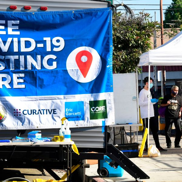 People check-in at a pop-up Covid-19 Test site in Los Angeles, California on October 29, 2020, where the testing is walk-up only with no appointments necessary and results in 48 hours. (Photo by Frederic J. Brown/AFP via Getty Images)