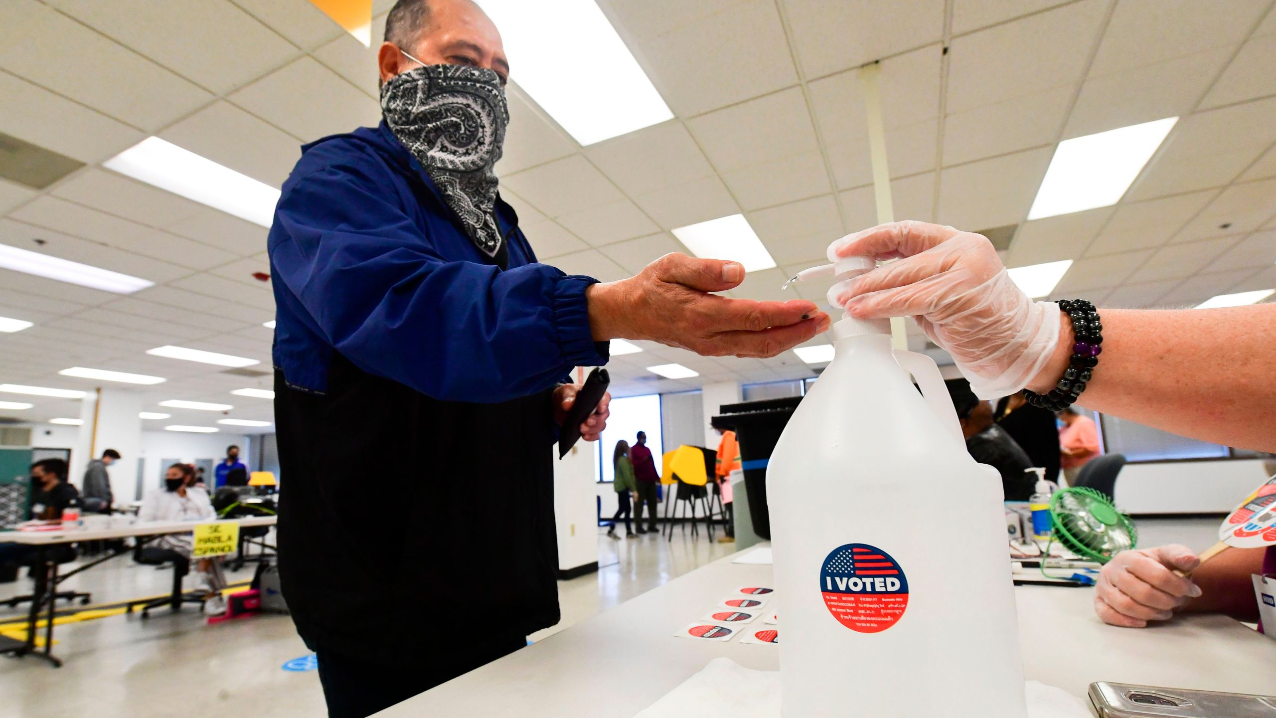 "An ""I Voted"" sticker is placed on a container of hand-sanitizer for voters at the Los Angeles County Registrar in Norwalk, California on Nov. 3, 2020.(FREDERIC J. BROWN/AFP via Getty Images)"
