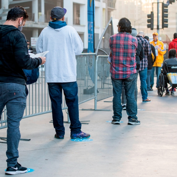 People wait in line to vote at the Staples Center on Nov. 3, 2020. (Valerie Macon / AFP / Getty Images)