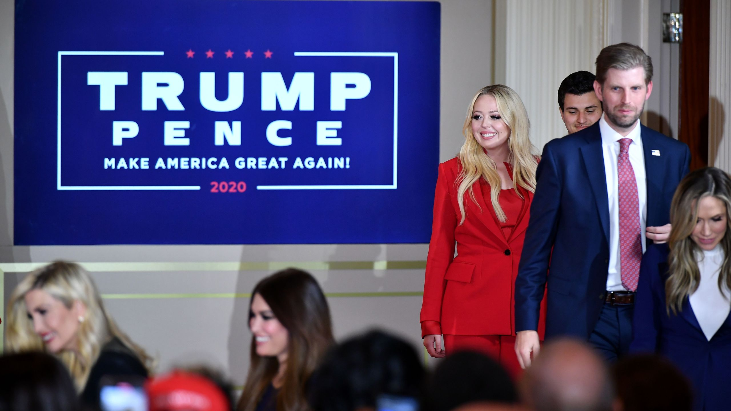 Daughter of the US President Tiffany Trump (L), her boyfriend Michael Boulos, Eric Trump, son of the president, and his wife Lara Trump arrive to hear the president speak during election night in the East Room of the White House in Washington, DC, early on Nov. 4, 2020. (MANDEL NGAN / AFP via Getty Images)