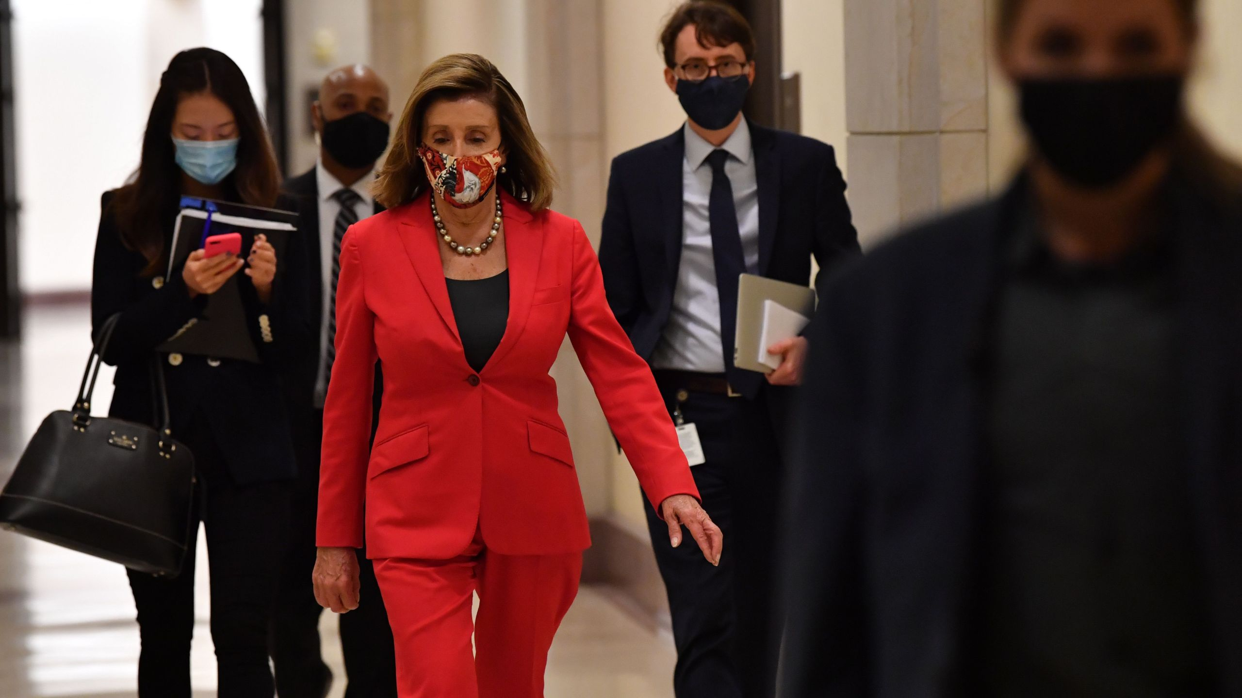 U.S. Speaker of the House, Nancy Pelosi, Democrat of California, leaves after her weekly press briefing on Capitol Hill in Washington, D.C., on Nov. 6, 2020. (NICHOLAS KAMM/AFP via Getty Images)