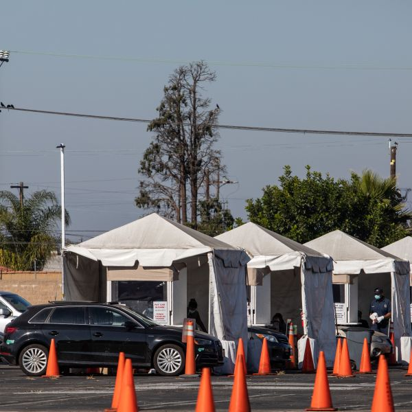 People wait in their cars at a drive-in COVID-19 testing site in South Los Angeles on Nov. 14, 2020. (Apu Gomes/AFP via Getty Images)