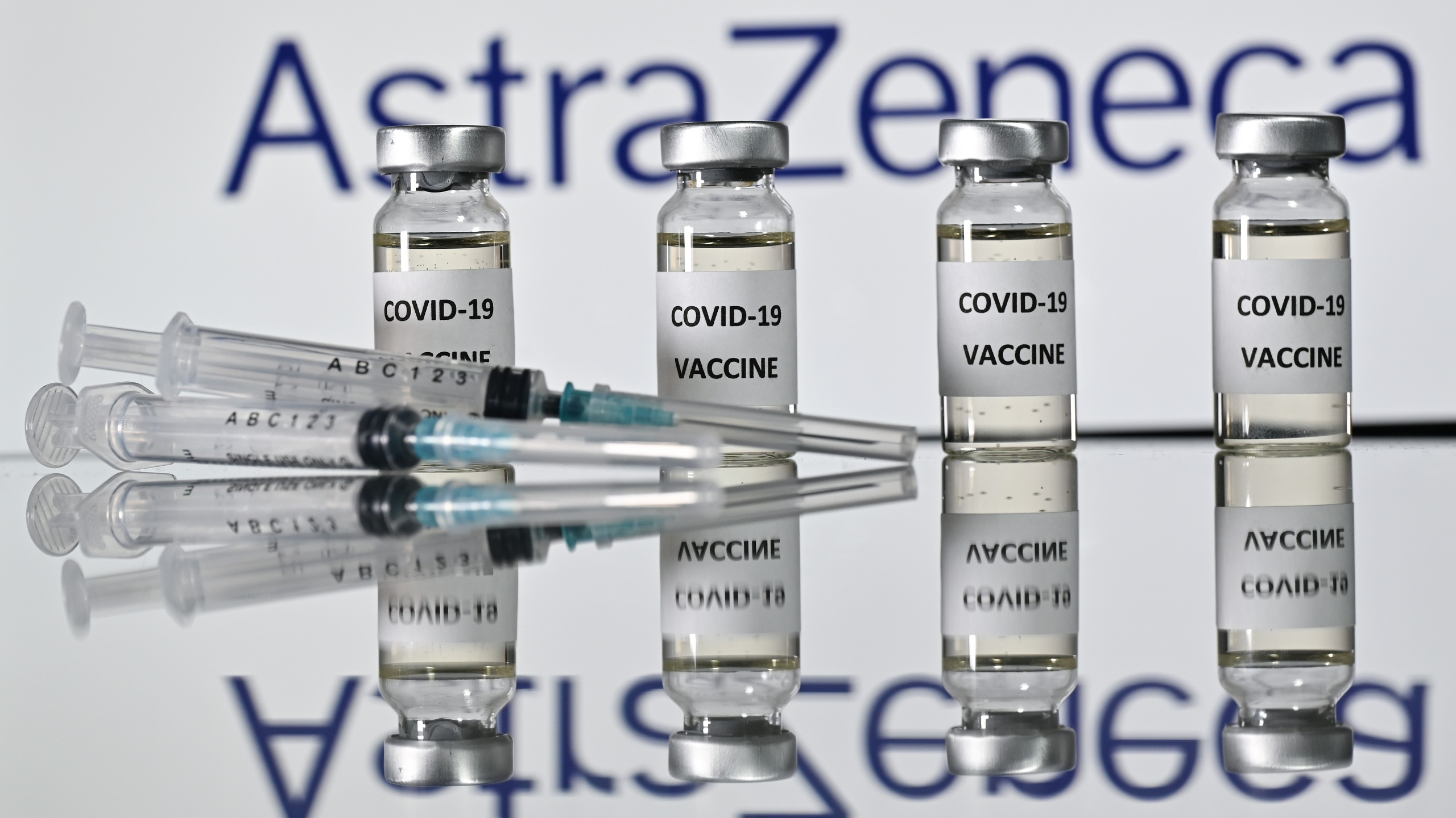 An illustration picture shows vials with Covid-19 Vaccine stickers attached and syringes with the logo of British pharmaceutical company AstraZeneca on November 17, 2020. (Justin Tallis/AFP via Getty Images)