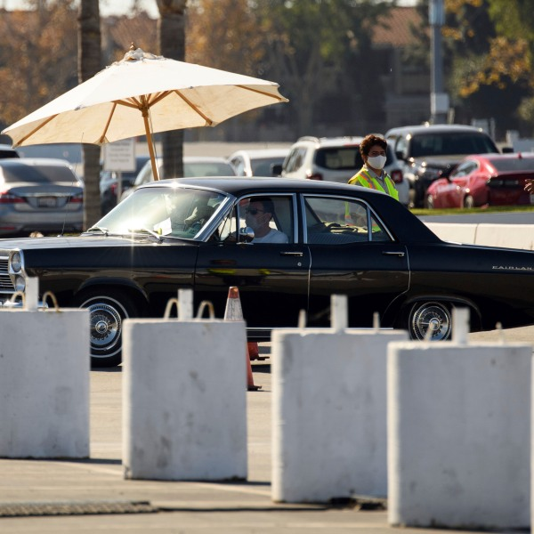 A vehicle enters a drive-up COVID-19 testing site at the Orange County Fairgrounds in Costa Mesa, California, November 17, 2020. (PATRICK T. FALLON/AFP via Getty Images)