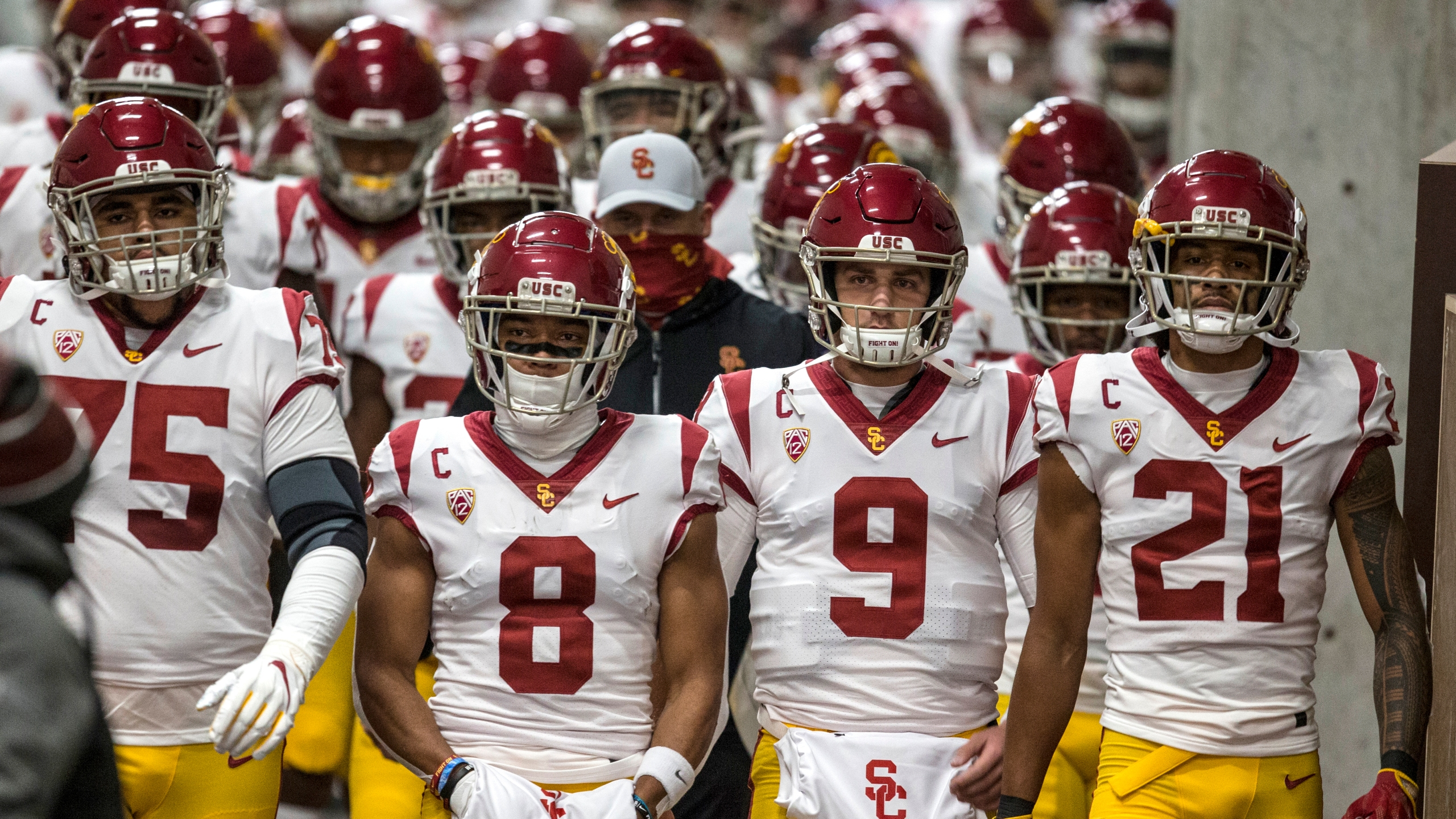 Alijah Vera-Tucker #75, Amon-Ra St. Brown #8, Kedon Slovis #9 and Tyler Vaughns #21 of the USC Trojans lead their team down the tunnel to the field before the start of their game against the Utah Utes November 21, 2020 at Rice Eccles Stadium in Salt Lake City, Utah. (Chris Gardner/Getty Images)