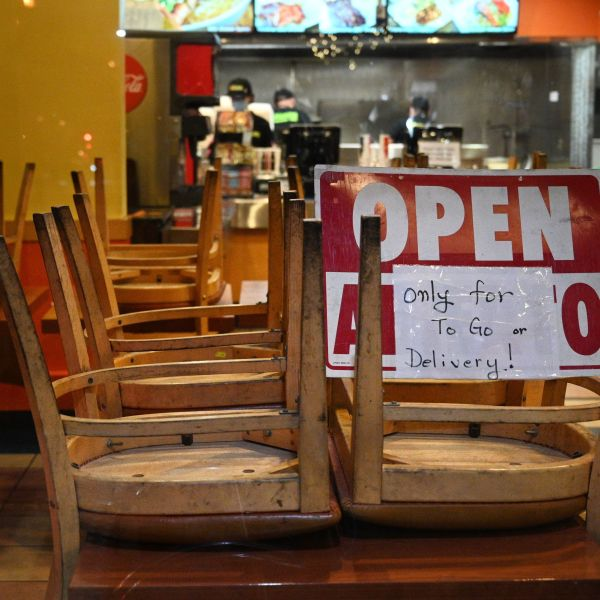 Employees work in a restaurant open for to-go or delivery orders only, in Burbank on Nov. 23, 2020. (ROBYN BECK/AFP via Getty Images)
