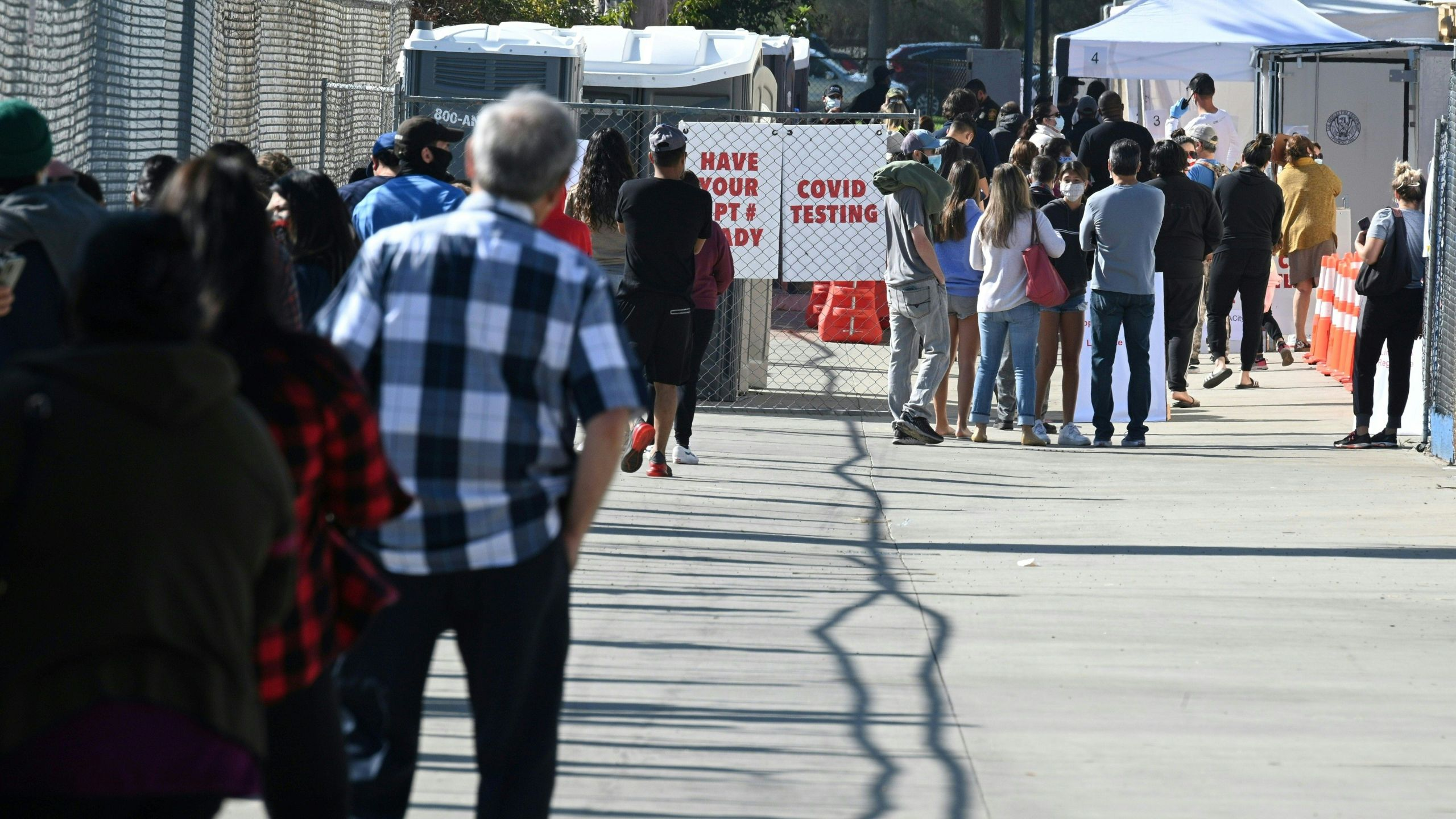 People wait in long lines for coronavius tests at a walk-up coronavirus testing site, Nov. 24, 2020, in San Fernando. (ROBYN BECK/AFP via Getty Images)