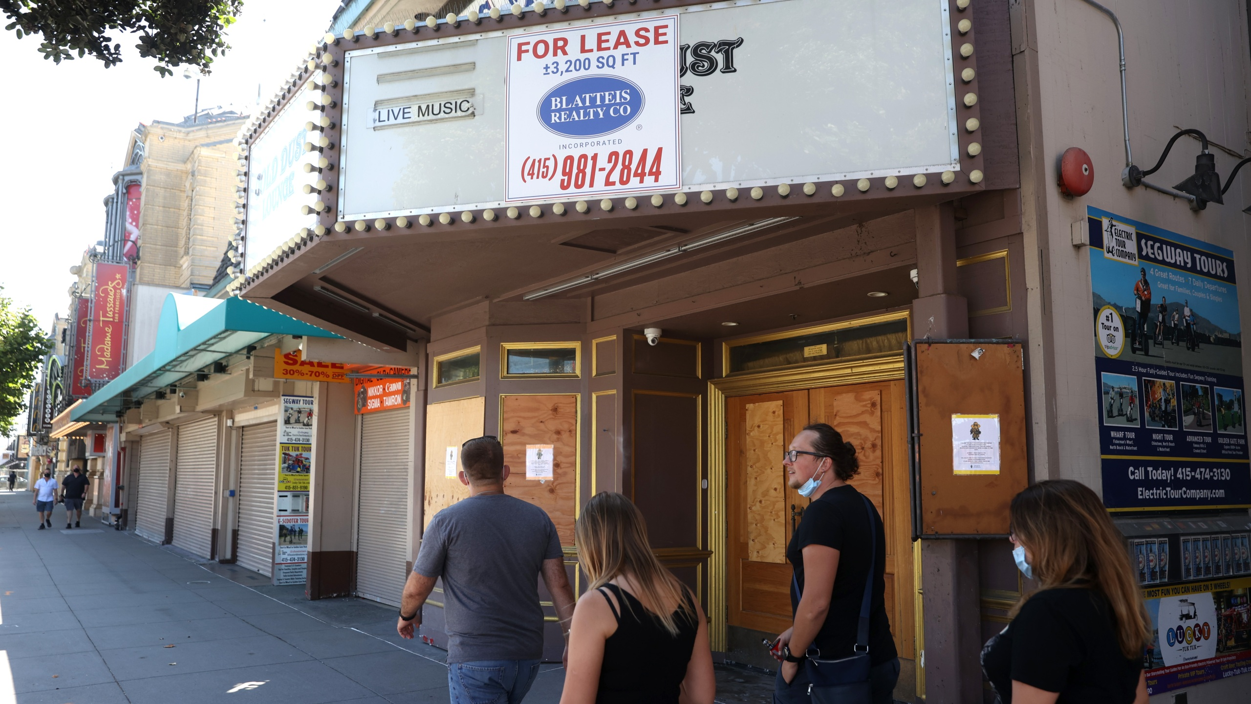 Pedestrians walk by the closed Gold Dust Lounge on Aug. 13, 2020 in San Francisco. (Justin Sullivan/Getty Images)