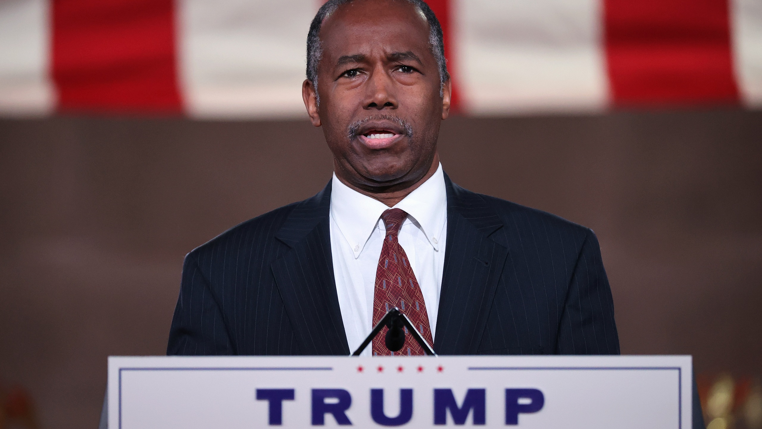 In a prerecorded address for the Republican National Convention released August 27, 2020, Housing and Urban Development Secretary Ben Carson speaks inside an empty Mellon Auditorium August 26, 2020 in Washington, DC. (Chip Somodevilla/Getty Images)
