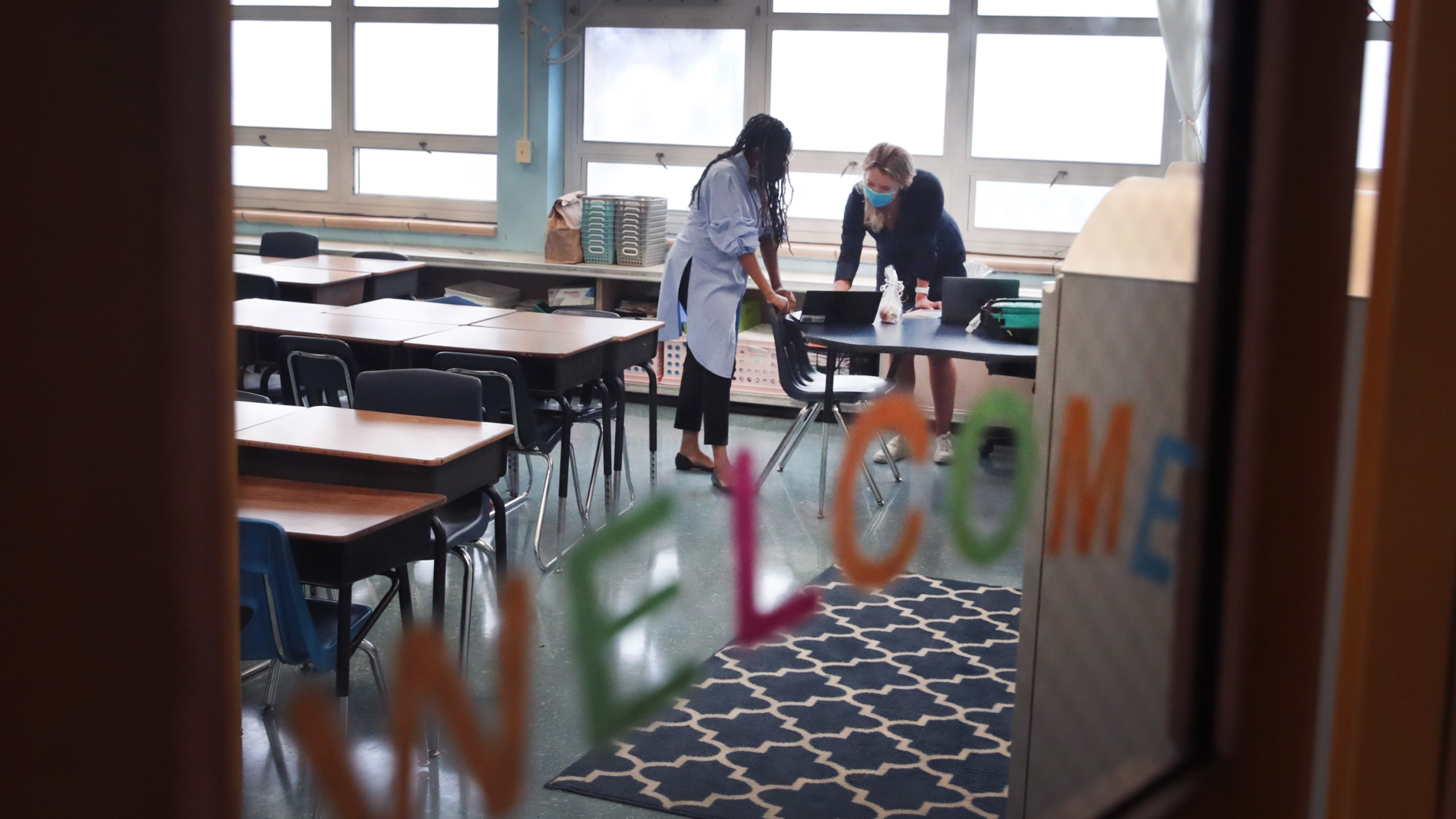 Jasmine Gilliam (L) and Lucy Baldwin, teachers at King Elementary School, prepare to teach their students remotely in empty classrooms during the first day of classes on September 08, 2020 in Chicago, Illinois. (Scott Olson/Getty Images)