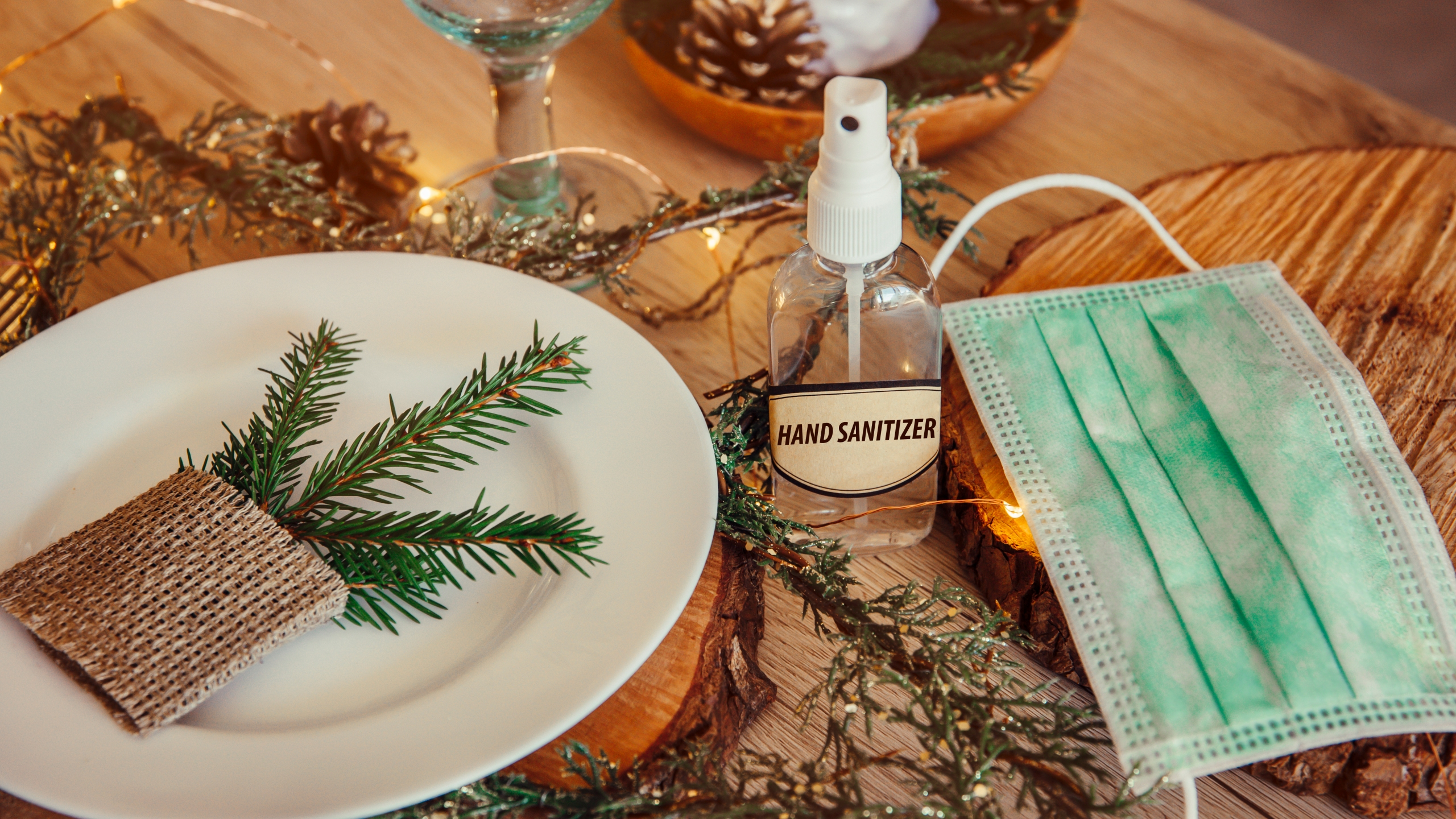 A holiday dinner setting featuring a face mask and hand sanitizer is seen in this undated file photo. (Getty Images)