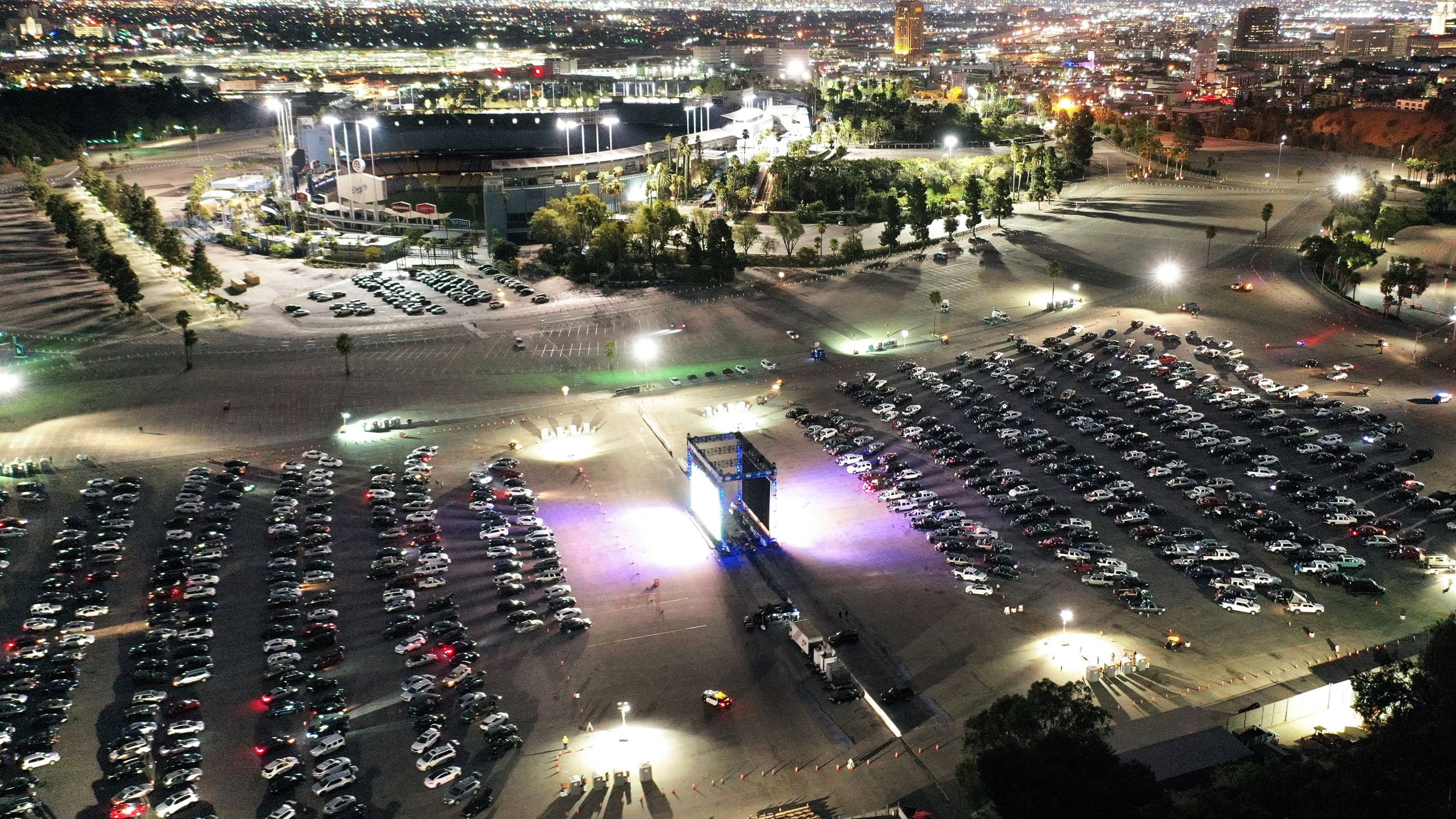 An aerial view of baseball fans attending a drive-in screening of Game 5 of the 2020 World Series between the Los Angeles Dodgers and the Tampa Bay Rays at a Dodger Stadium parking lot on Oct. 25, 2020. (Mario Tama/Getty Images)