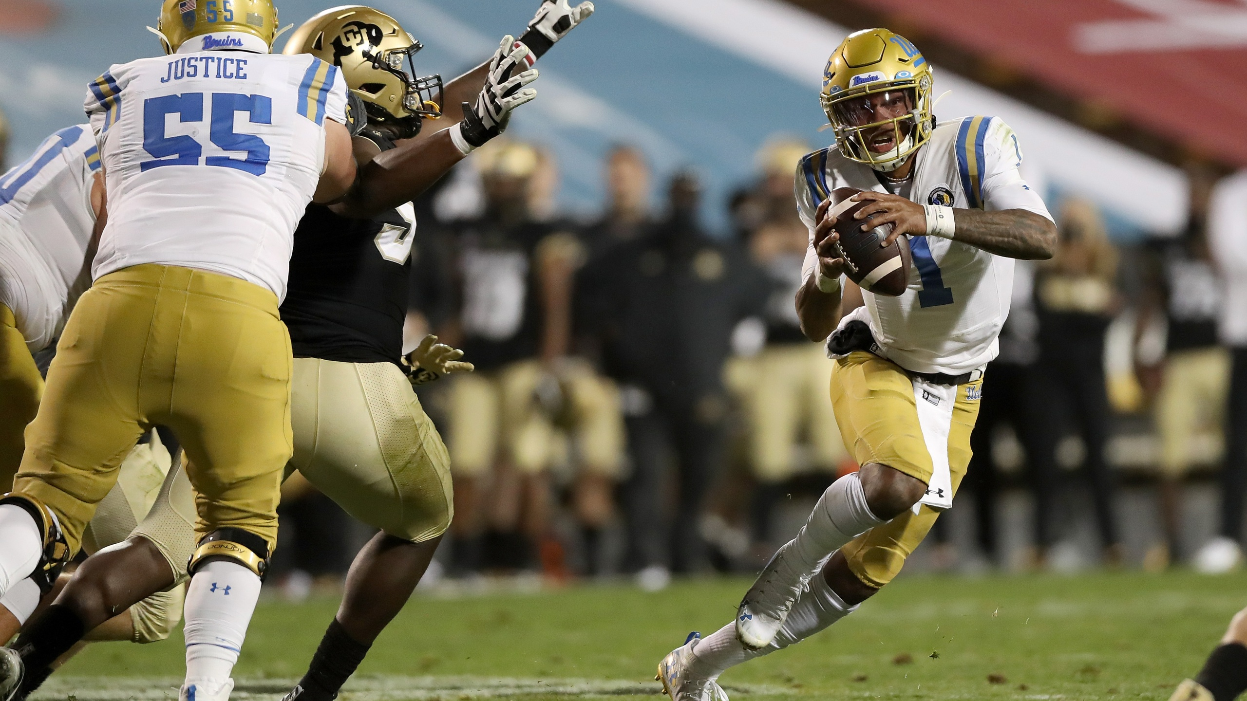 Quarterback Dorian Thompson-Robinson #1 of the UCLA Bruins runs out of the pocket against the Colorado Buffaloes in the fourth quarter at Folsom Field on November 07, 2020 in Boulder, Colorado. (Matthew Stockman/Getty Images)